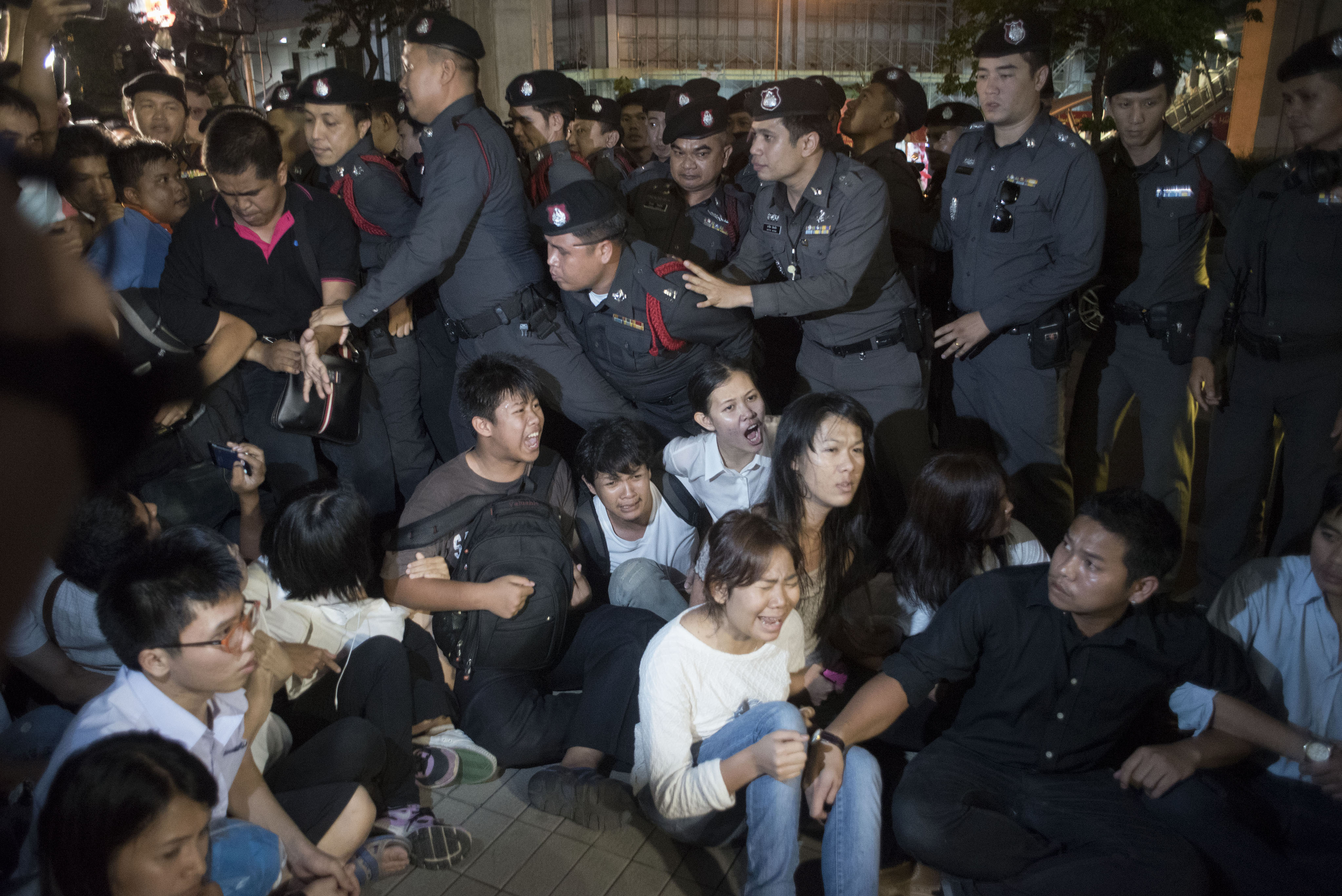 Thai police arrest students during an antijunta demonstration on May 22, 2015, in Bangkok