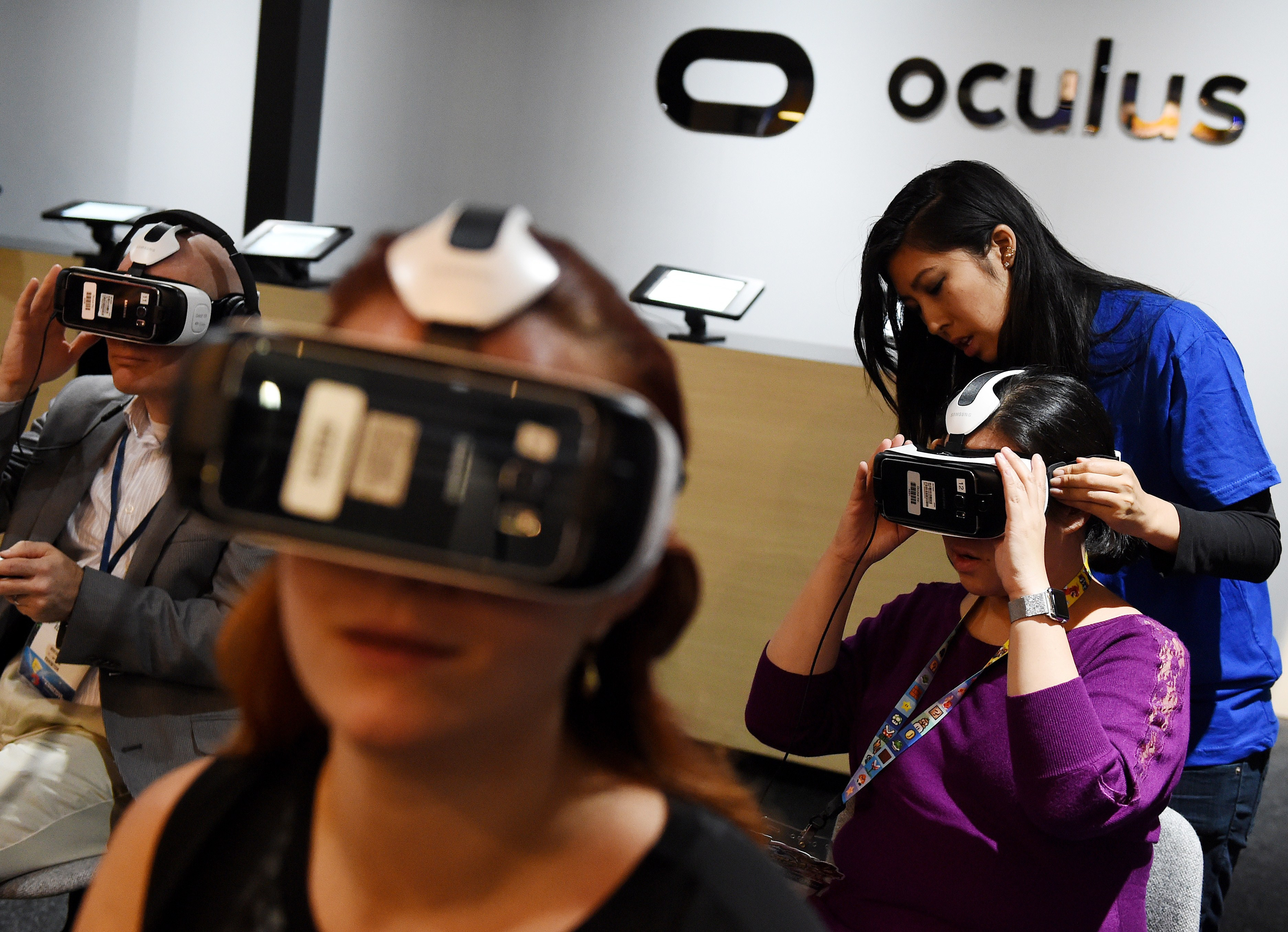 Gamers test a new Virtual Reality game headset at the Oculus display on the second day of the Electronic Entertainment Expo, known as E3 at the Convention Center in Los Angeles, California on June 17, 2015.