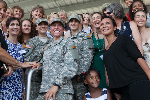 FORT BENNING, GA - AUGUST 21:  First Lt.  Shaye Haver (center) and Capt. Kristen Griest (center right) are surrounded by a group of female friends and supporters after receiving their Ranger tab and graduating from the United States Army's Ranger School during a ceremony at Fort Benning, Georgia on August 21, 2015.  Griest and Haver are the first females to graduate from the Army's intensive Ranger School.  (photo by Jessica McGowan/Getty Images)