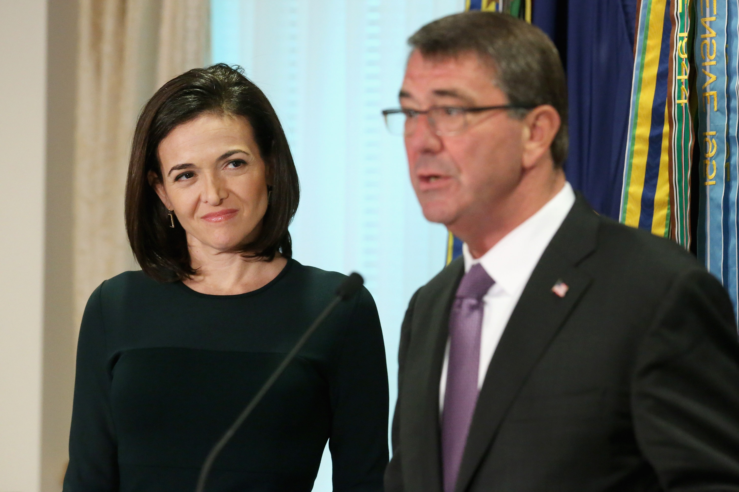 Facebook Chief Operating Officer and founder of LeanIn.Org Sheryl Sandberg (L) and U.S. Defense Secretary Ashton Carter deliver remarks after hosting a 'Lean In Circle' with female members of the military at the Pentagon September 21, 2015 in Arlington, Virginia. Carter announced that the Department of Defense will now allow and encourage men and women in the armed forces to form and participate in 'Lean In Circles,' small groups of people who meet regularly and offer peer support while talking openly about gender issuses.