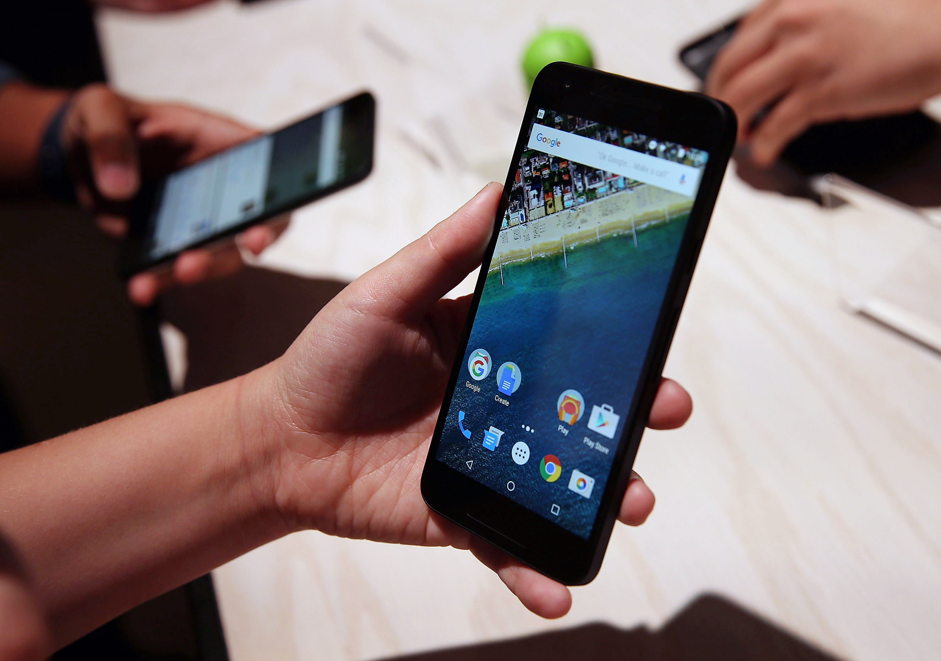 An attendee inspects the new Nexus 5X phone during a Google media event on September 29, 2015 in San Francisco, California.