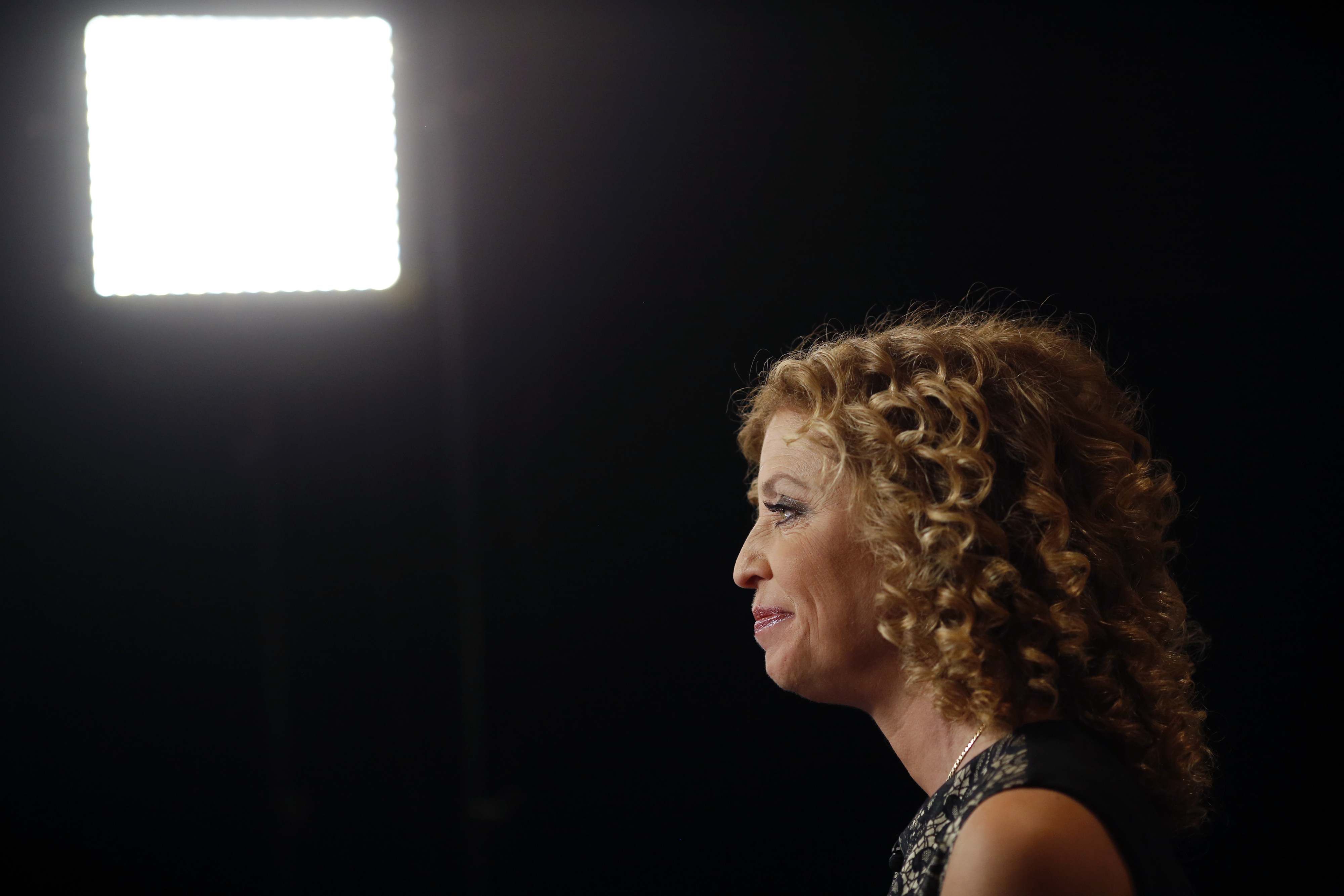 Representative Debbie Wasserman Schultz, Democratic National Committee Chairwoman and a Democrat from Florida, sits for an interview before the first Democratic presidential debate hosted by CNN in Las Vegas, Nevada, U.S., on Tuesday, Oct. 13, 2015.