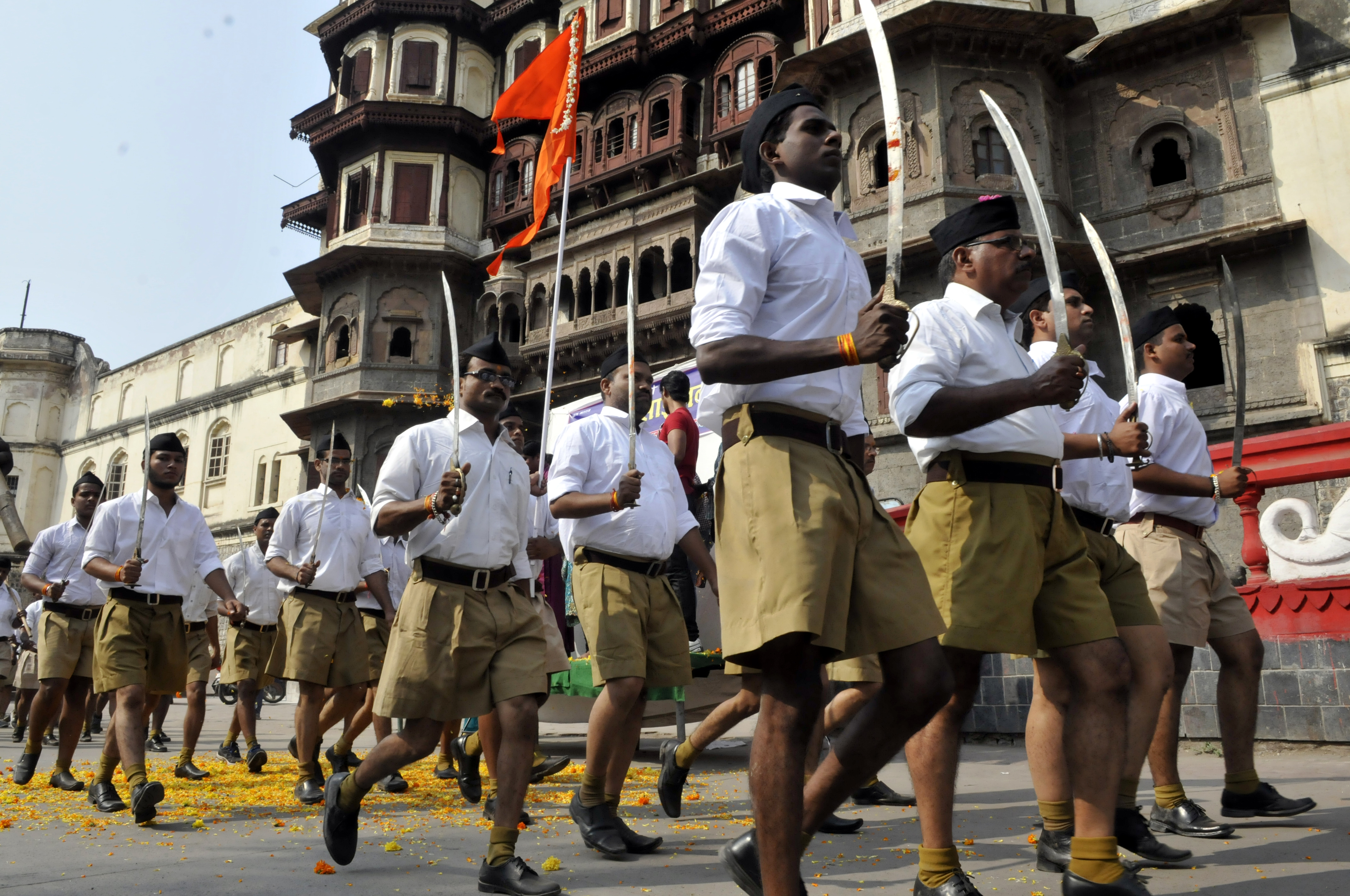 RSS volunteers queue up for an annual march at Jehangirabad area in Indore, India, on Oct. 22, 2015