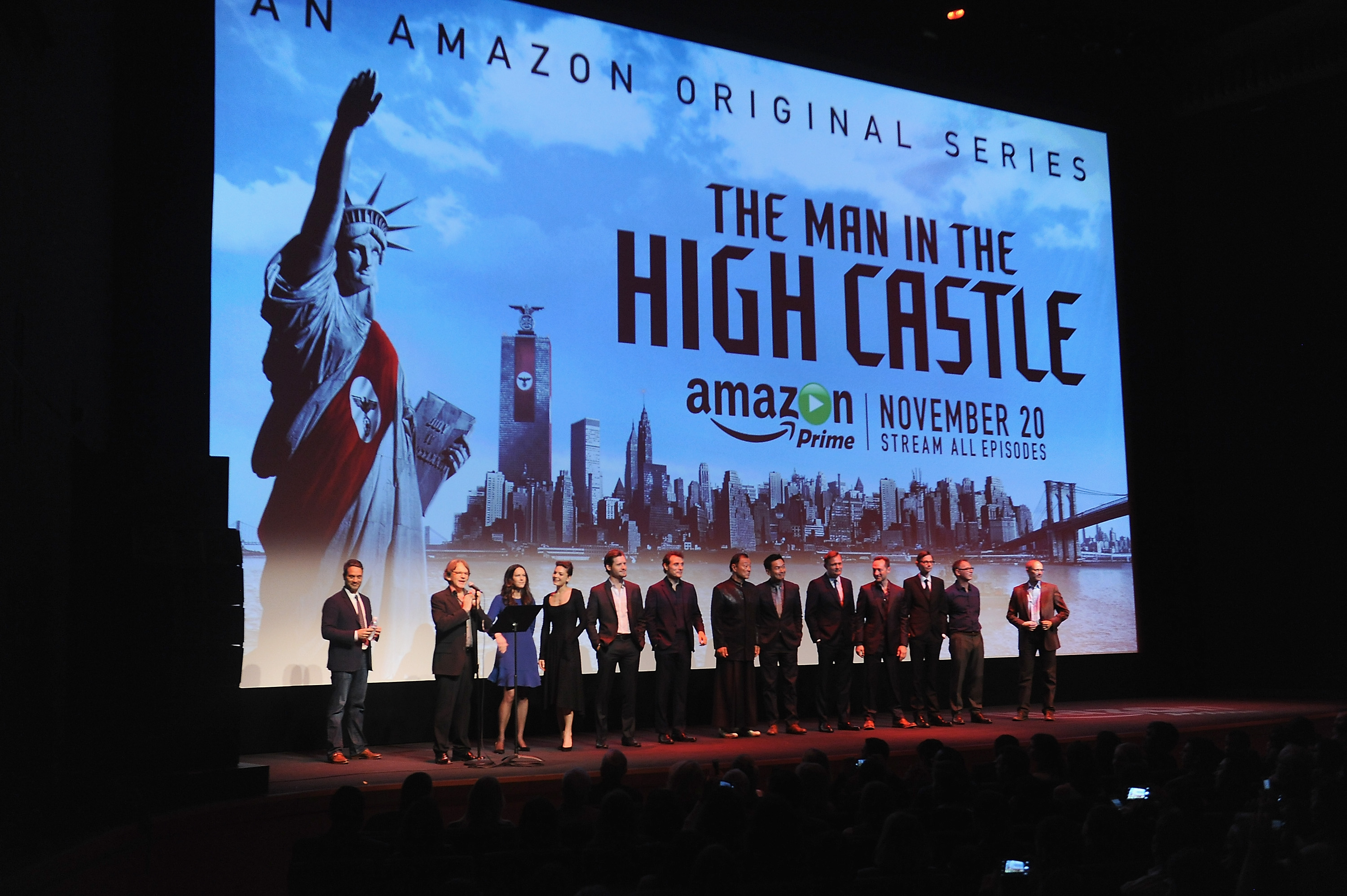 NEW YORK, NY - NOVEMBER 02:  (L-R) Morgan Wandell,Frank Spotnitz ,  Isa Dick Hackett, Alexa Davalos, Luke Kleintank, Rufus Sewell, Cary-Hiroyuki Tagawa, Joel de la Fuente, Carsten Norgaard, and DJ Qualls on stage during the New York premiere of Amazon Original's  Man In The High Castle  at Alice Tully Hall on November 2, 2015 in New York City.