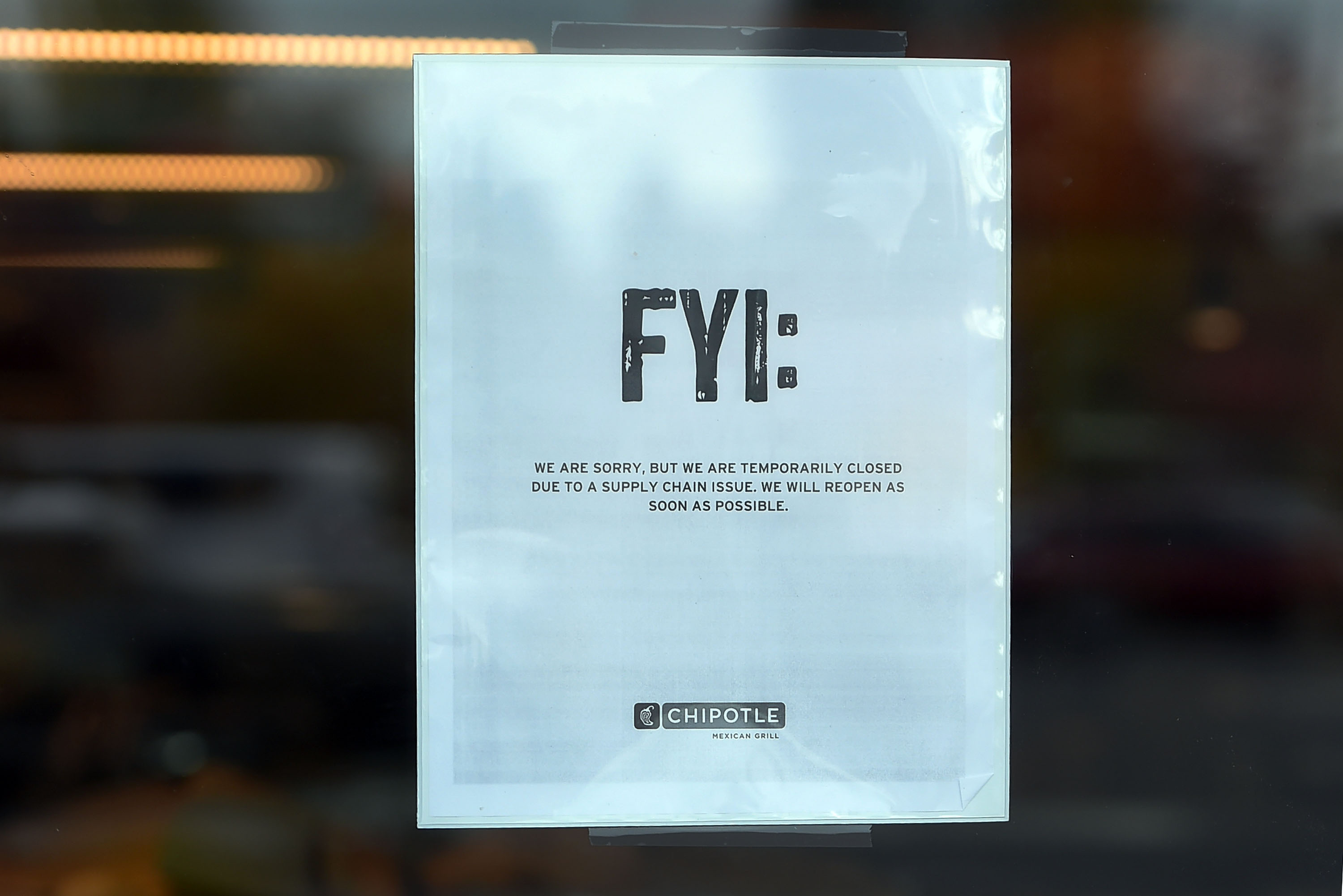 A sign hangs on the door of a Chipotle Mexican Grill store location in on November 3, 2015 in Vancouver, Washington.  Chipotle Mexican Grill is temporarily closing more than 40 restaurants in and around Washignton and Oregon, as health officials investigate an E. coli outbreak.