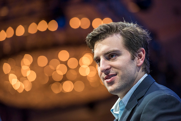 Brian Chesky, co-founder and chief executive officer of Airbnb Inc., listens during the 2015 Fortune Global Forum in San Francisco, California, U.S., on Wednesday, Nov. 4, 2015