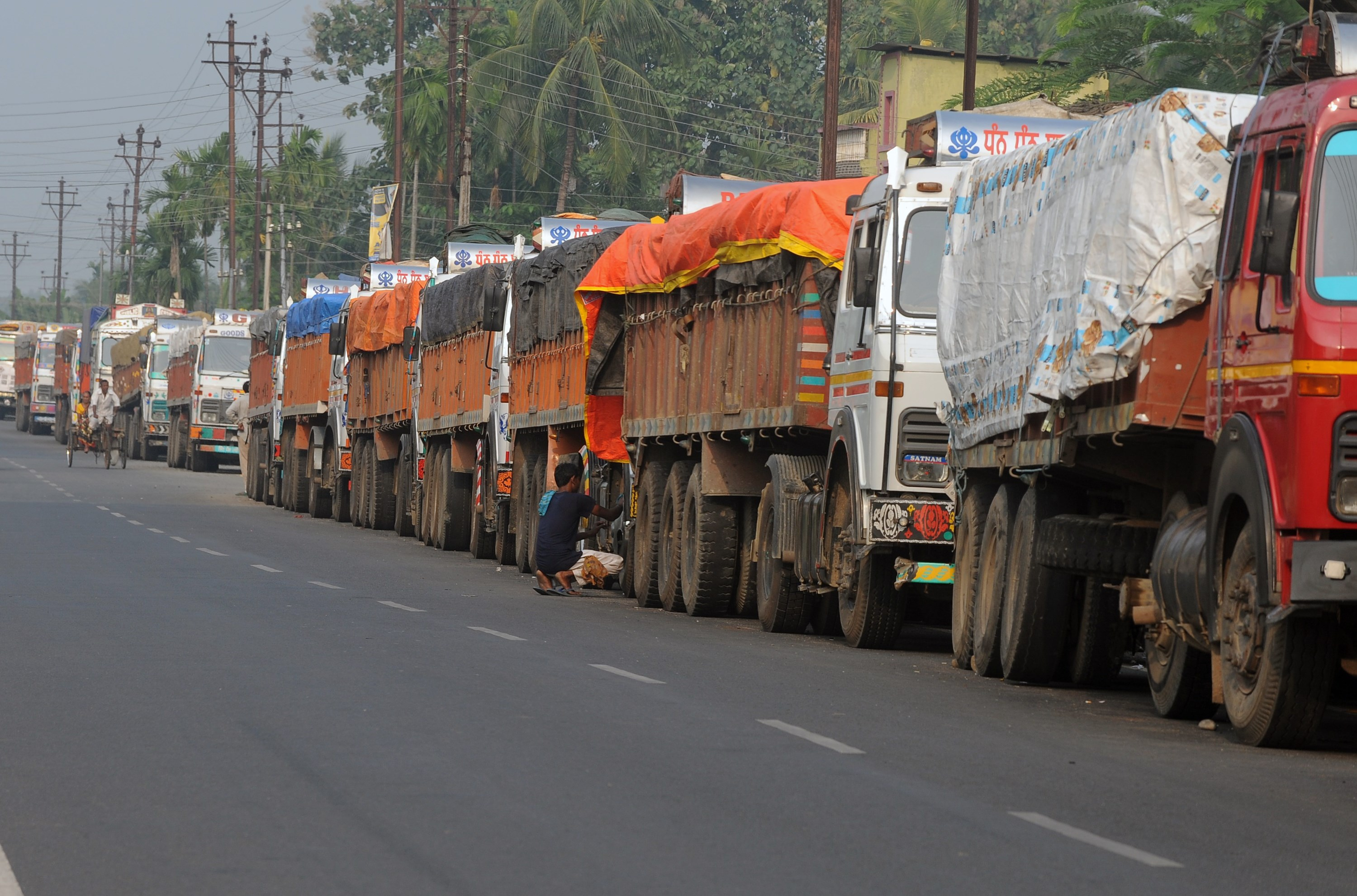 Indian trucks loaded with goods are seen parked near the India-Nepal border at Panitanki on Nov. 5, 2015