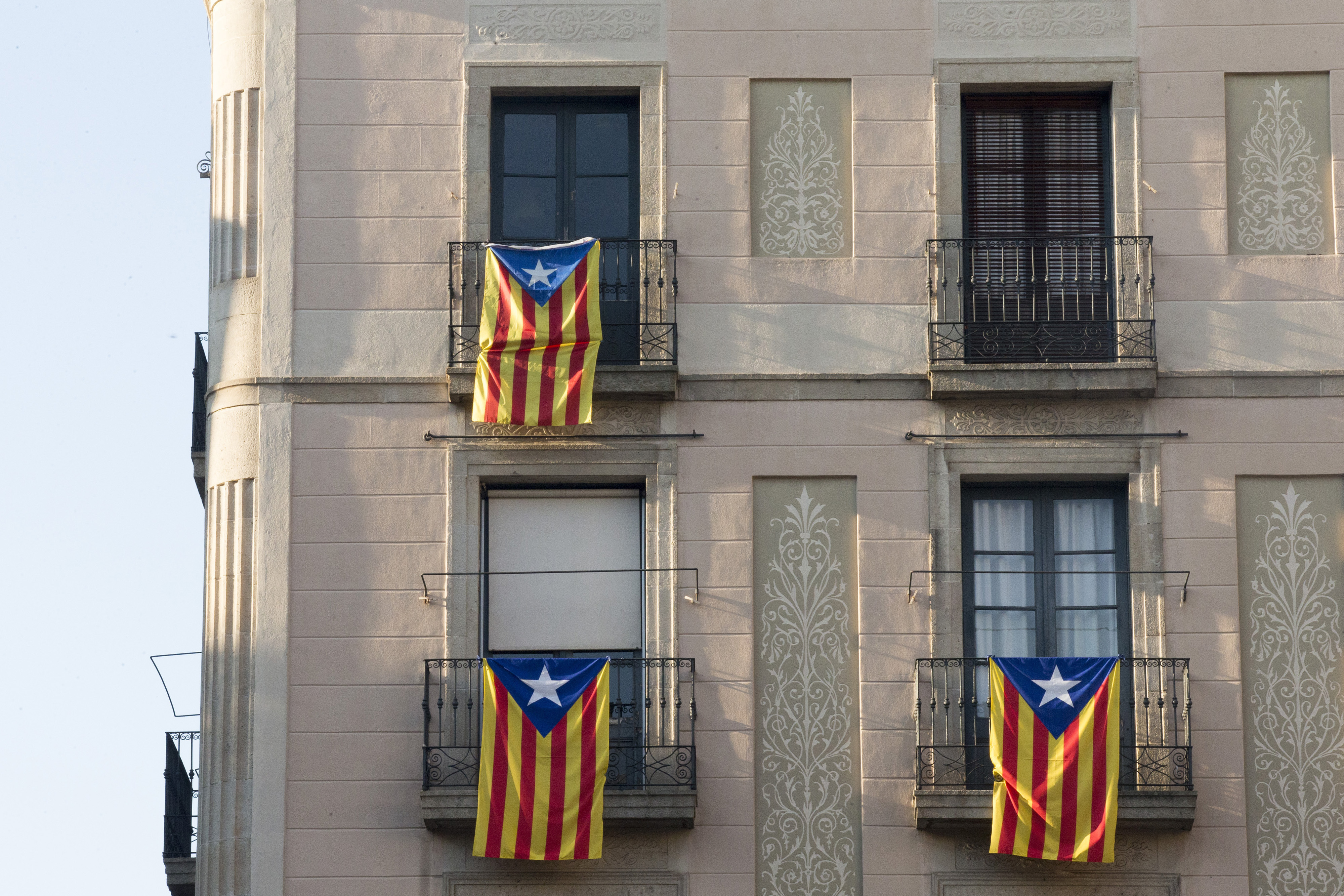 Pro-independent Catalonia flags hang from the balcony of a residential home in Barcelona, Spain, Nov. 9, 2015