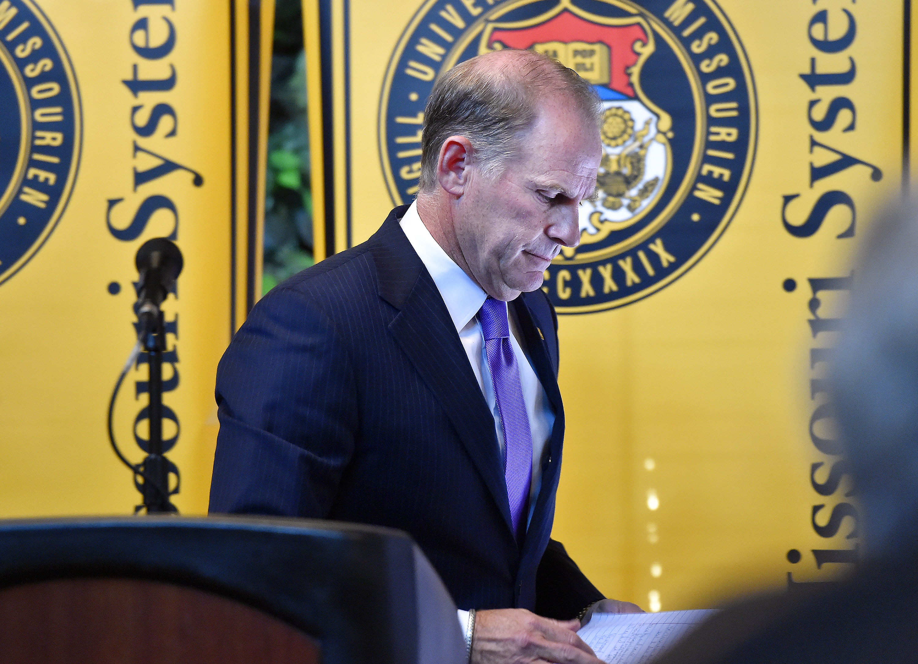 University of Missouri system President Tim Wolfe walks away from the lecturn after he announced his resignation during a news conference on Monday, Nov. 9, 2015, in Columbia, Mo. Wolfe resigned after pressure from students who say he has not done enough to respond to recent racially-motivated incidents on the Columbia campus.