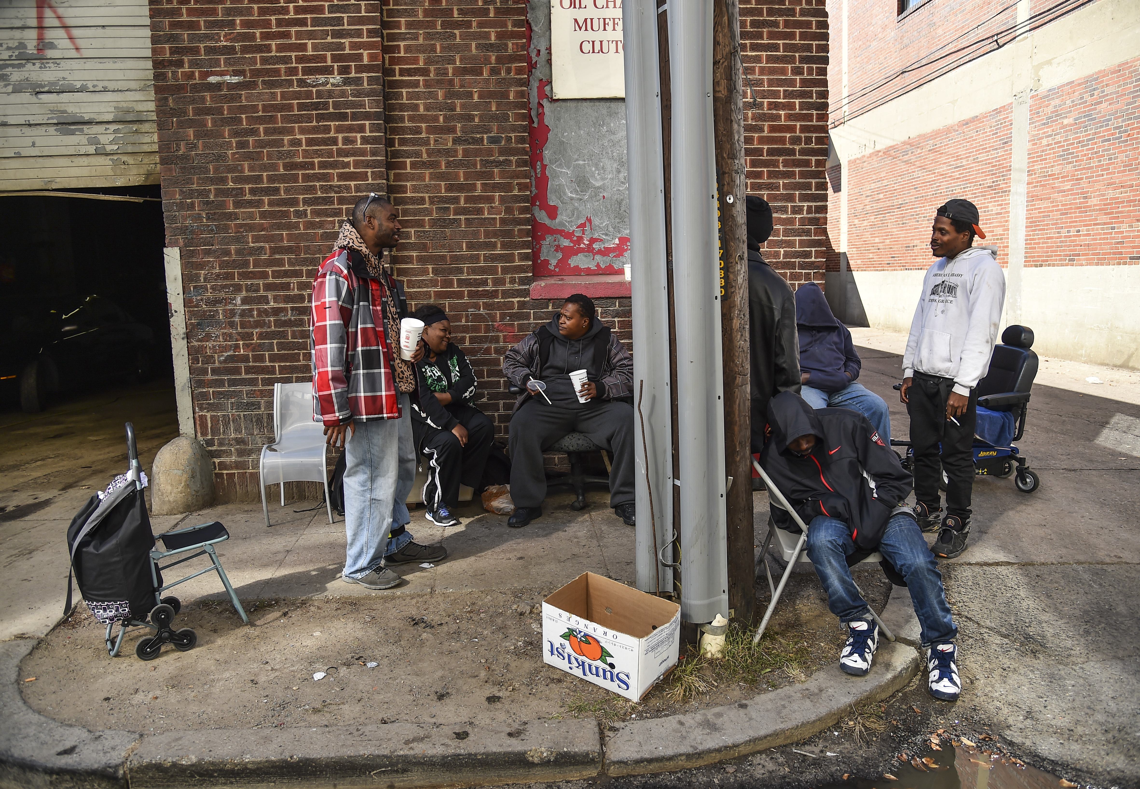 Members of a homeless community hang out on the sidewalk in the Ivy City neighborhood in Washington, D.C., on Oct. 16, 2015