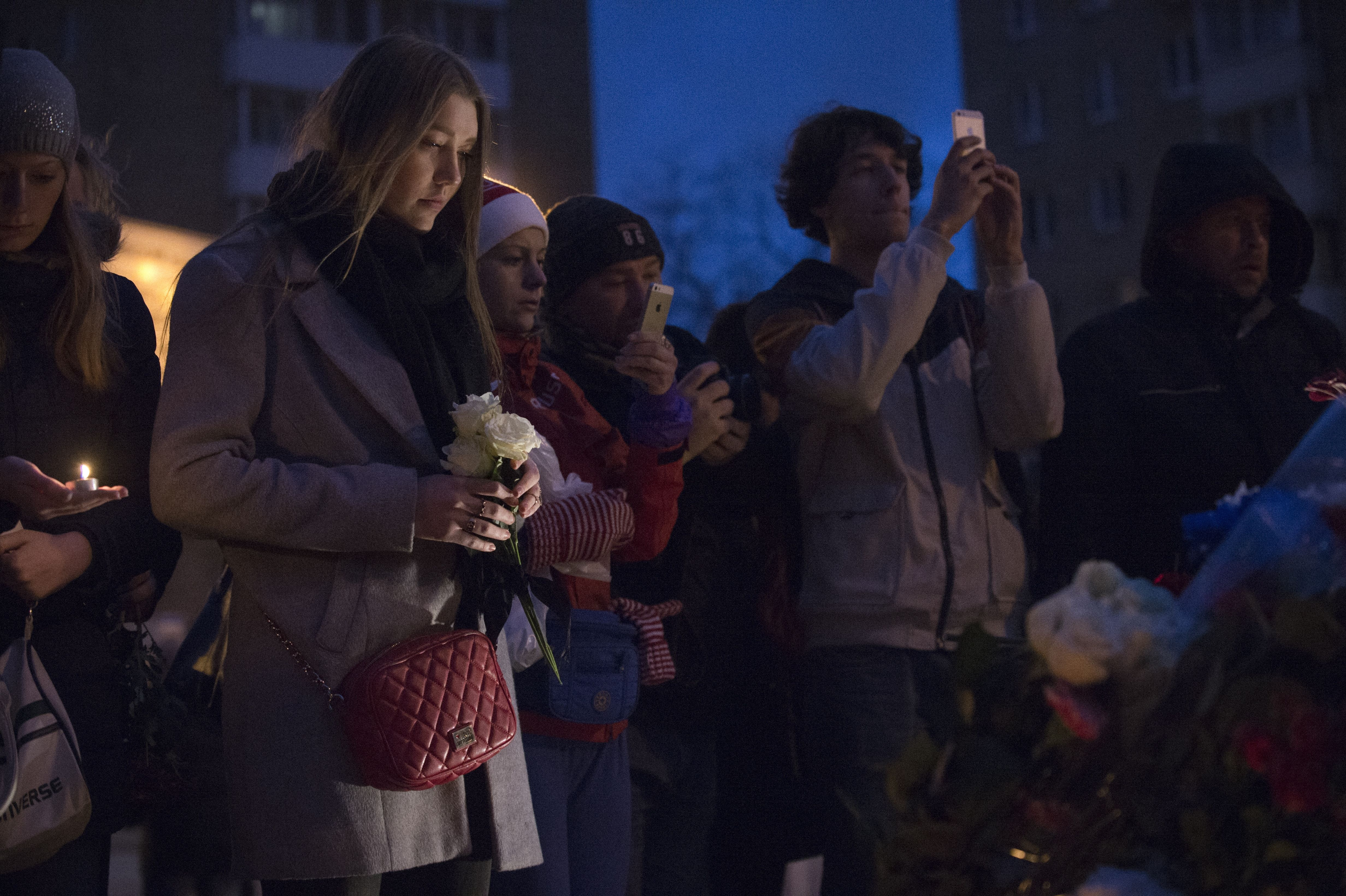 People gather outside the French embassy in Moscow on Nov. 14, 2015.