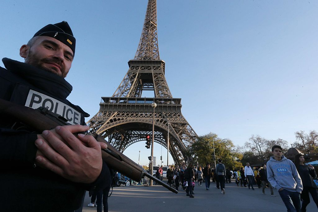 The Eiffel tower is closed and guarded by police following Friday's terrorist attacks in Paris.