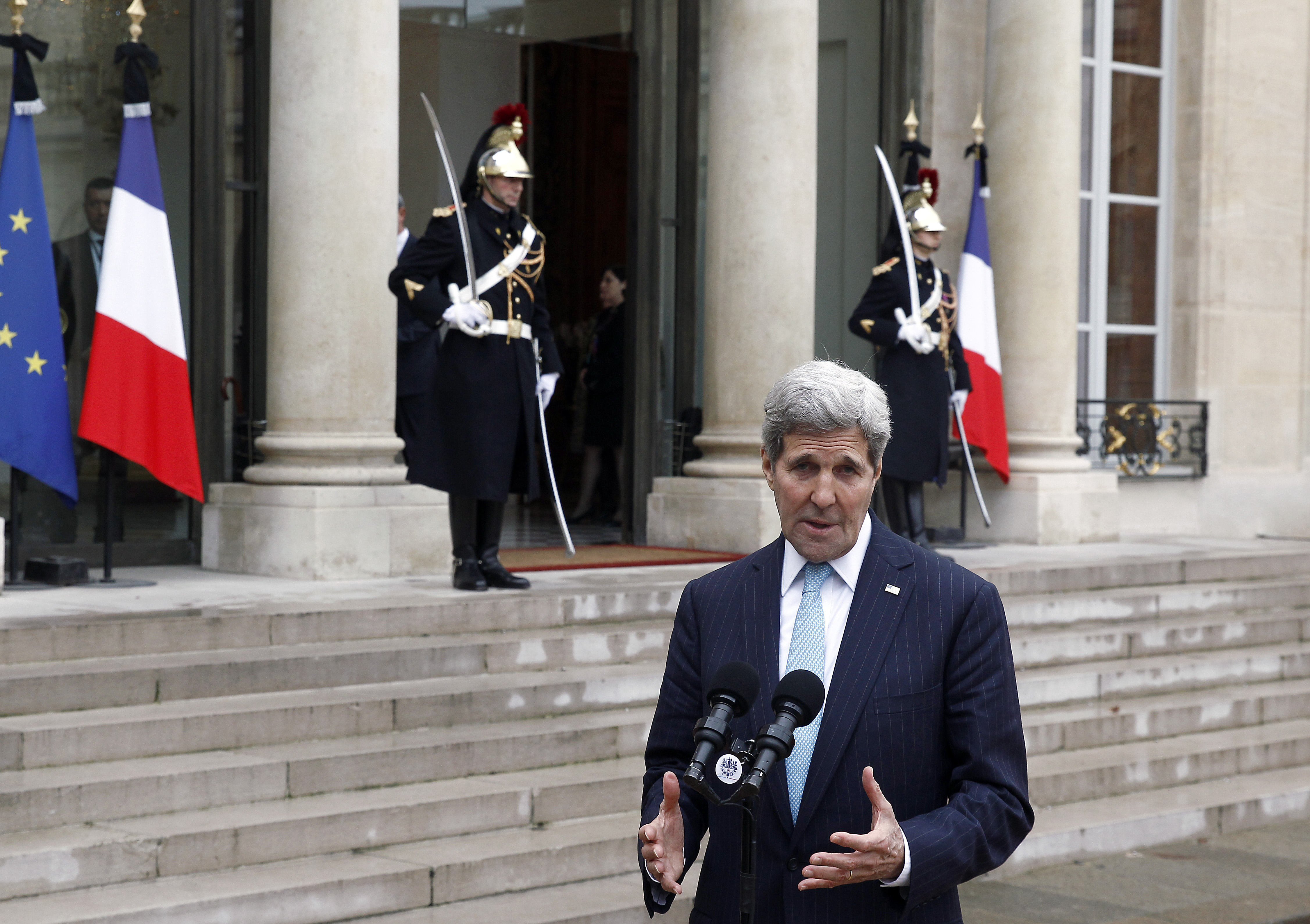 US Secretary of State John Kerry talks to the media after a meeting with French President Francois Hollande at the Elysee Presidential Palace on November 17, 2015 in Paris, France. John Kerry arrives in Paris to pay tribute to victims of last week's terrorist attacks.
