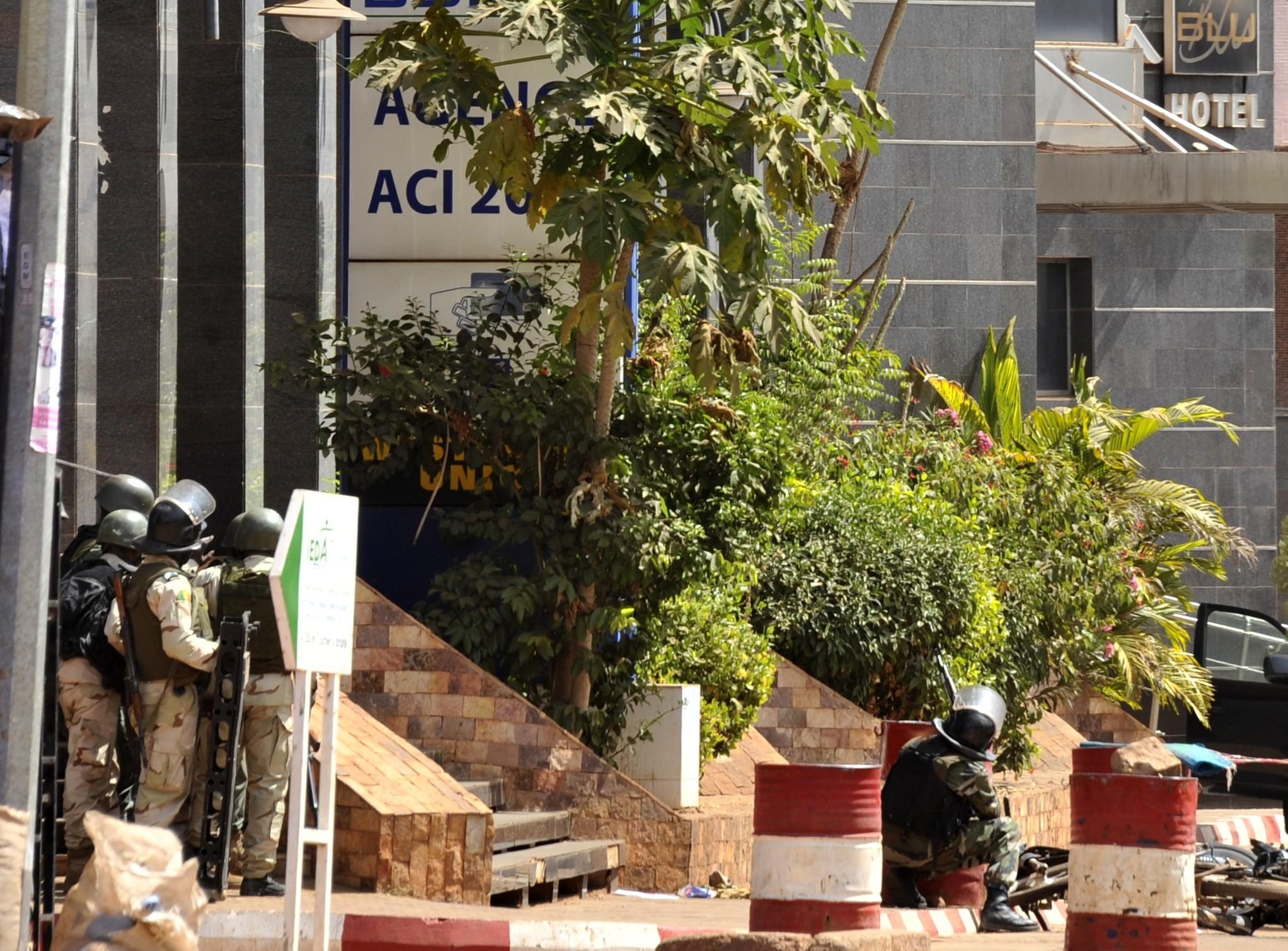 Malian troops take position outside the Radisson Blu hotel in Bamako on Nov. 20, 2015