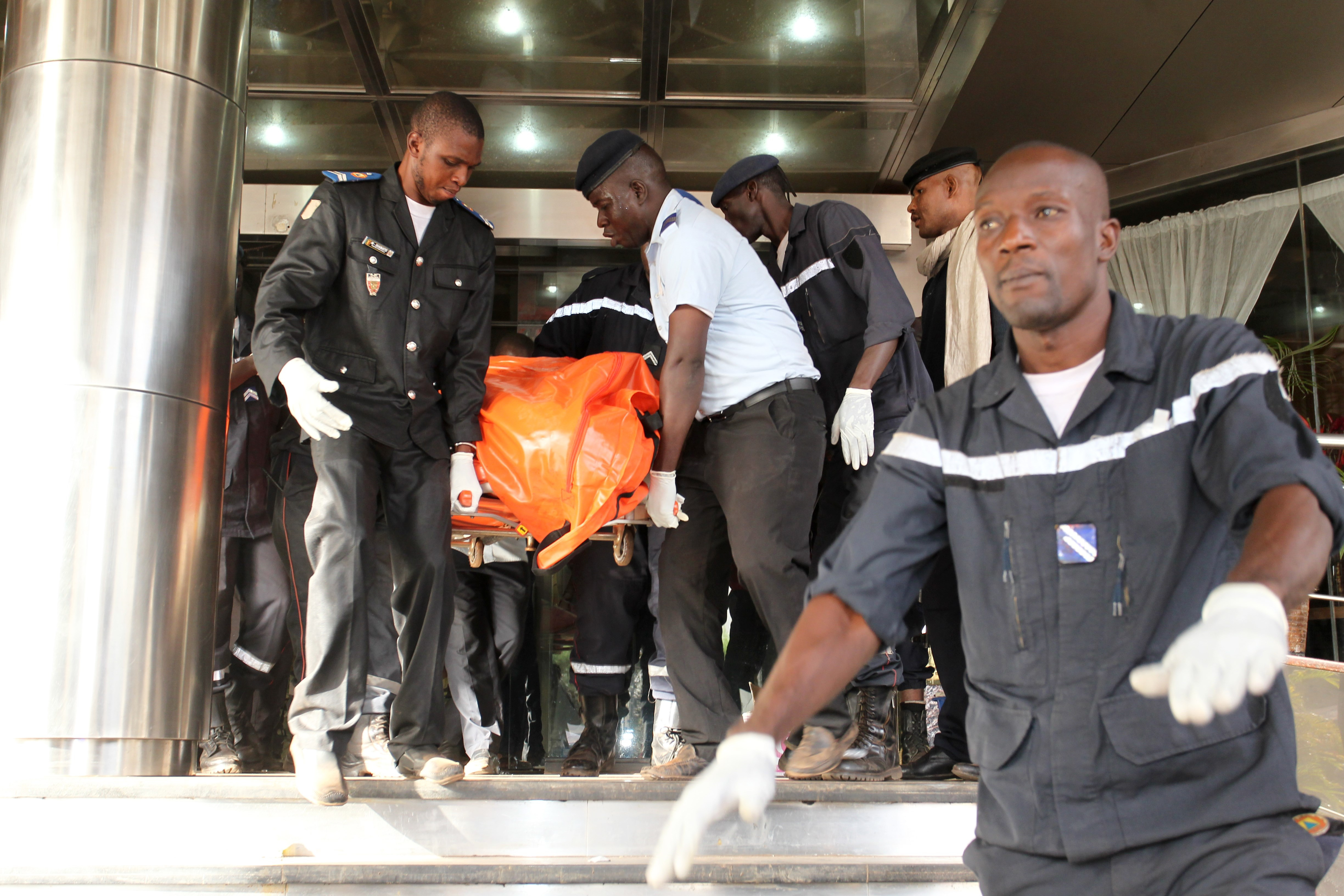Officers evacuate bodies of victims from the Radisson Blu Hotel in Bamako, Mali,  on Nov. 20, 2015, where at least 19 people, including 3 Chinese executives, died