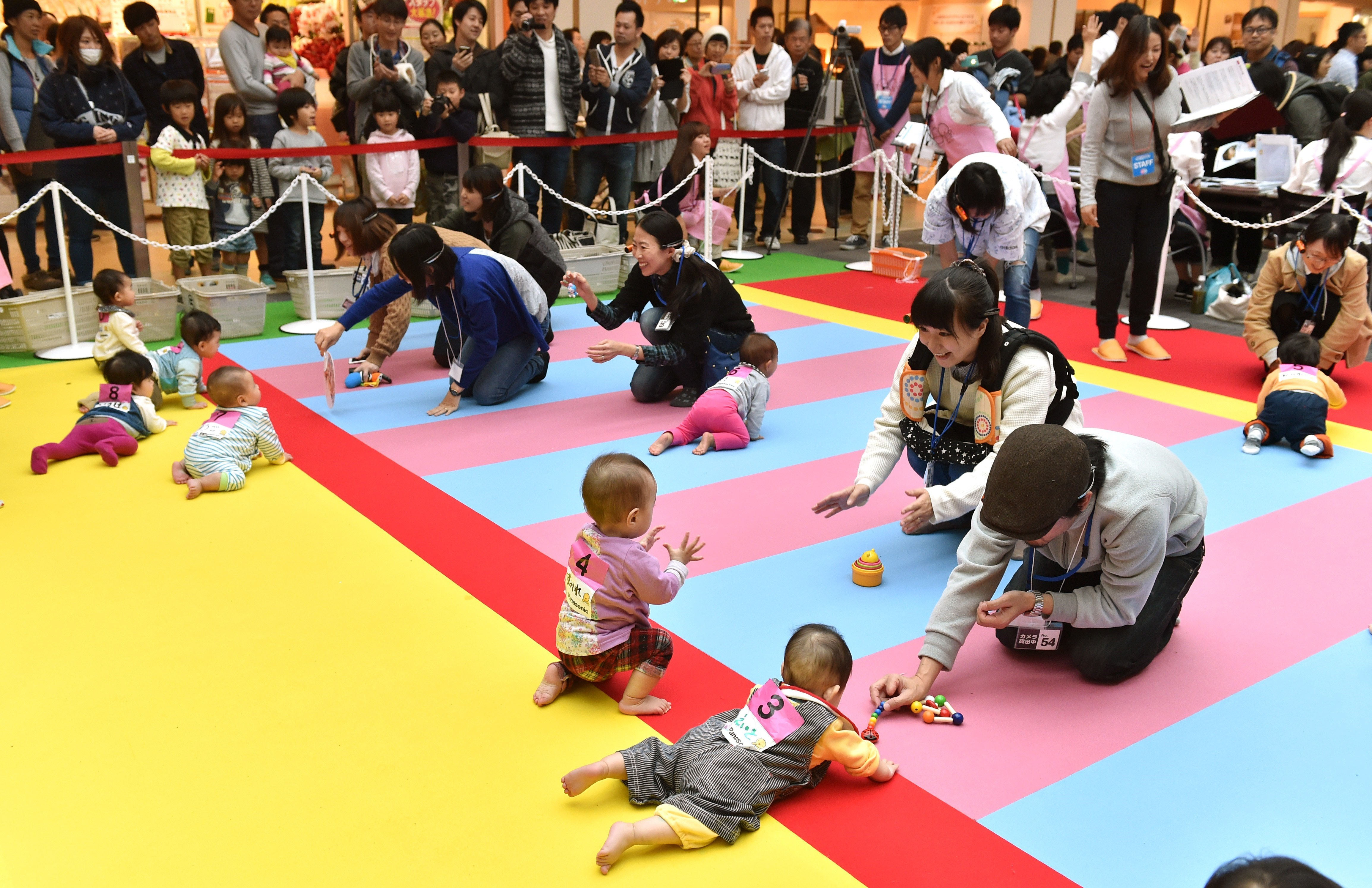 Babies compete in a baby crawling competition hosted by a Japanese magazine that specializes in pregnancy, childbirth and child-rearing, in Yokohama, Kanagawa on Nov. 23, 2015.