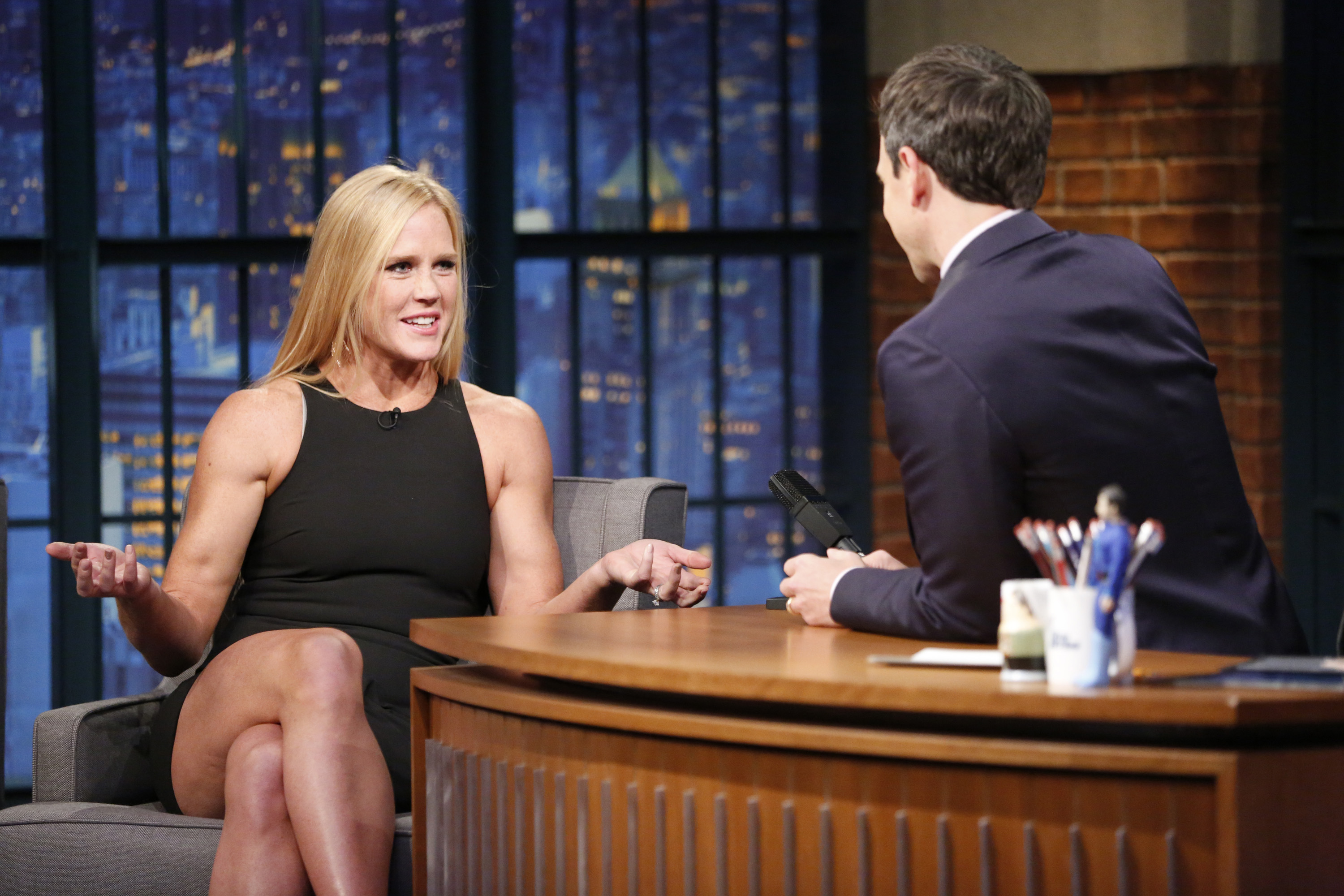 Pictured: (l-r) Holly Holm, UFC Women's Bantamweight Champion, during an interview with host Seth Meyers on November 18, 2015.