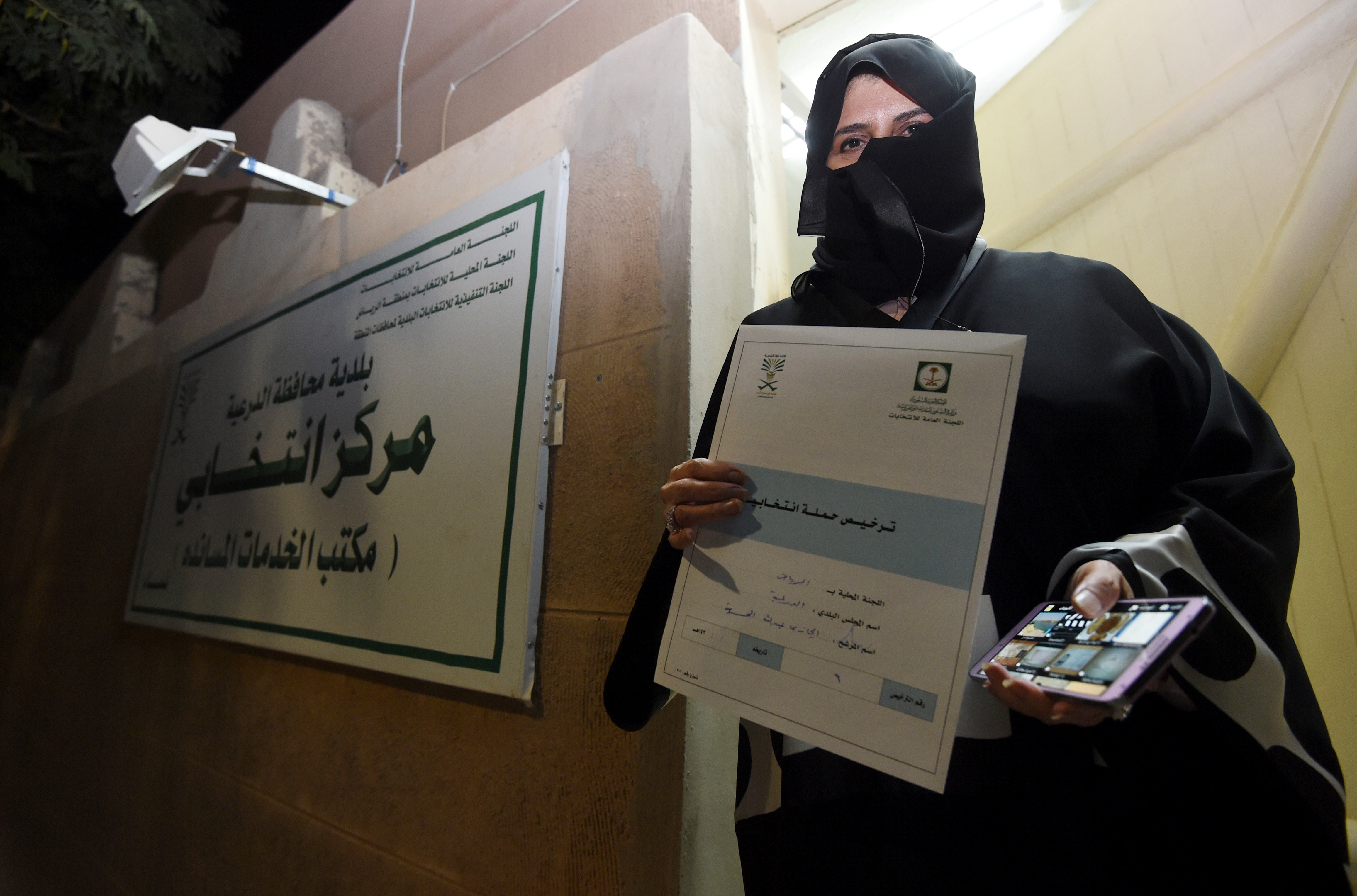 Aljazi al-Hussaini, a candidate for the municipal council in the town of Diriyah, on the outskirts of the Saudi capital Riyadh, shows an electoral campaign license issued by the central municipal elections committee on November 29, 2015.