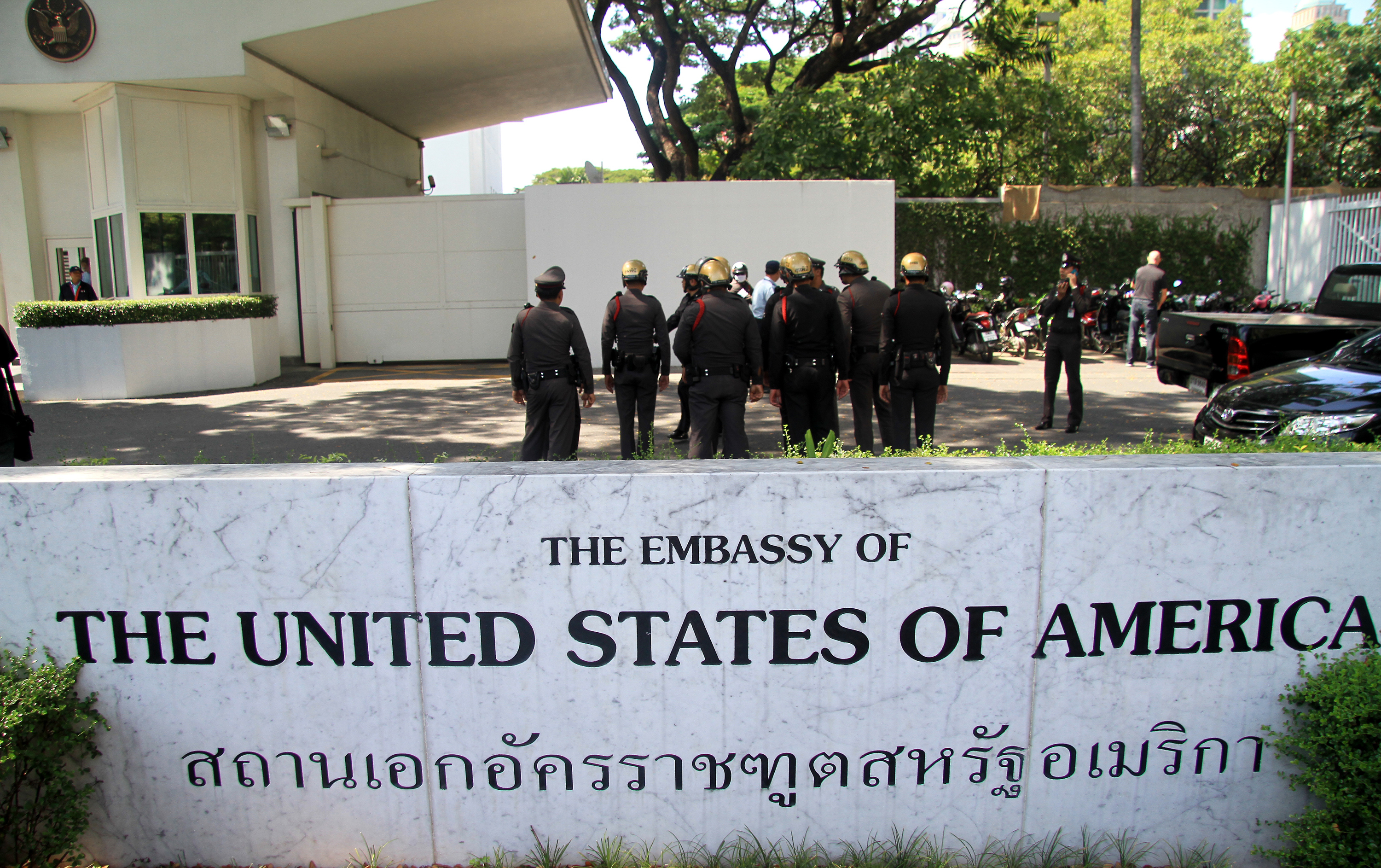 Policemen huddled on the grounds of the grounds of the U.S. Embassy in Bangkok on Nov. 27, 2015