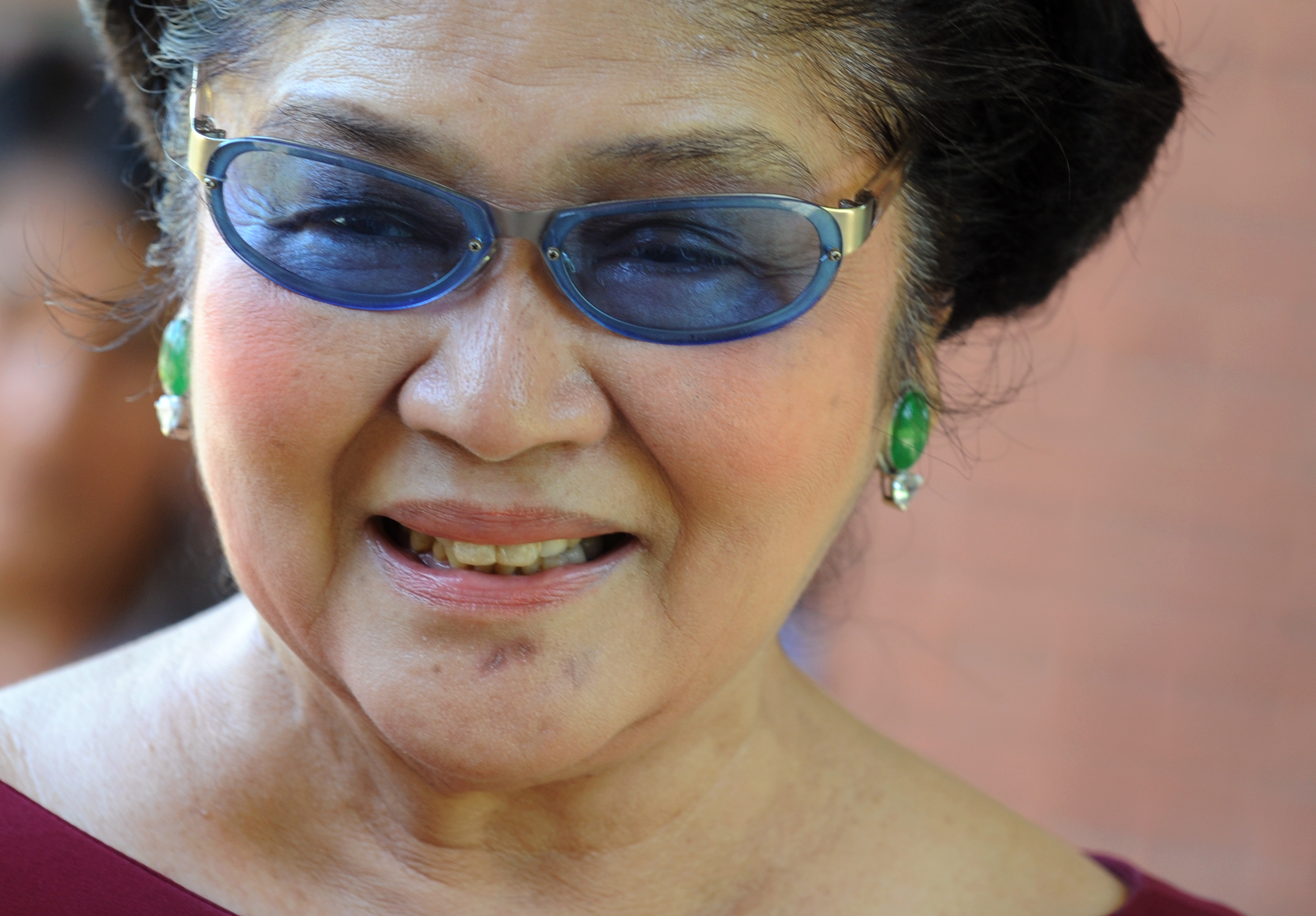 Philippine former first lady Imelda Marcos smiles while meeting supporters in Laoag city, northern province of Ilocos Norte, on May 13, 2010.