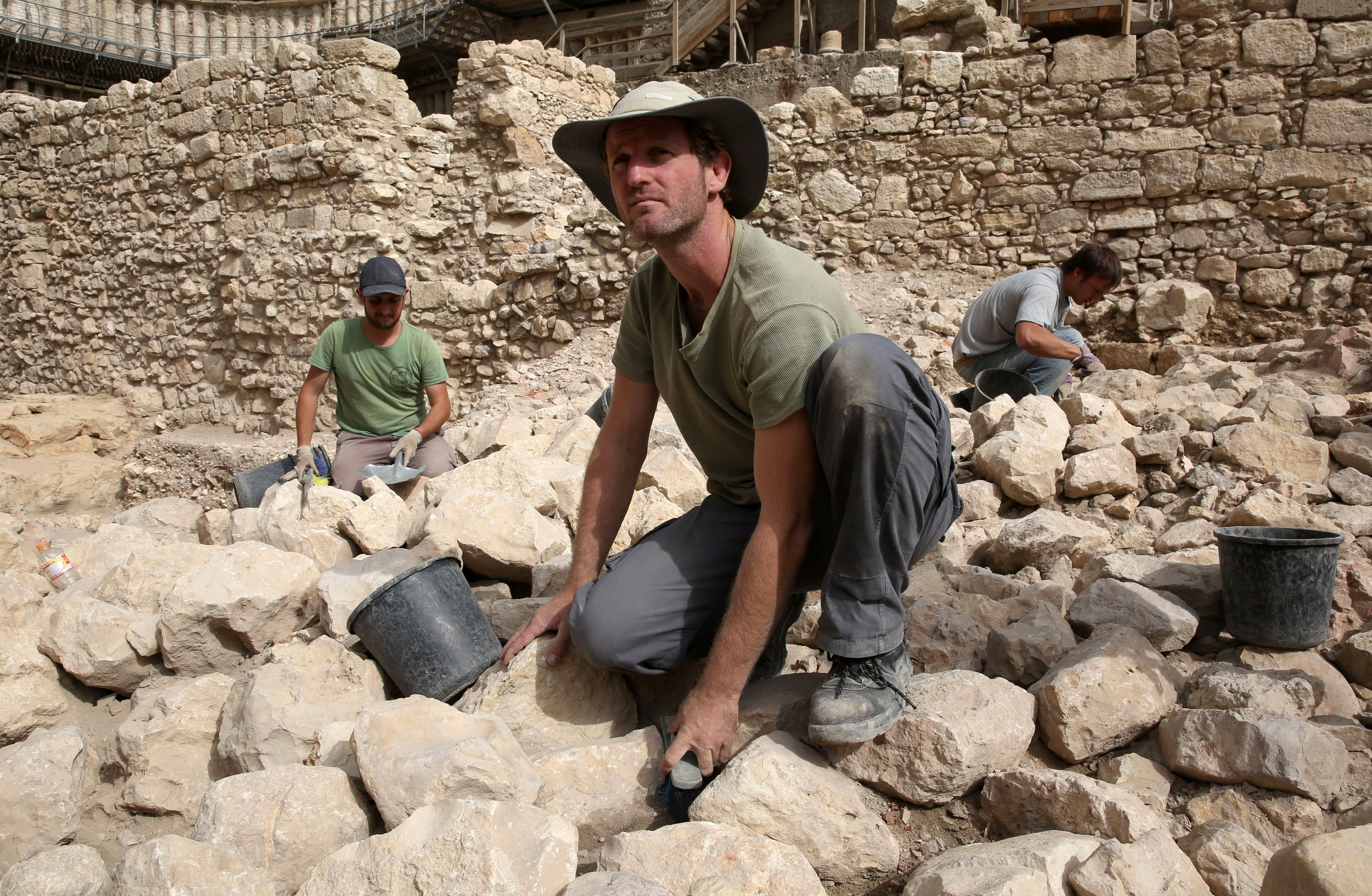 Workers from the Israeli Antiquity Authorities dig on November 3, 2015 at the excavation site near the City of David adjacent to Jerusalem's Old City walls where researchers believe to have found the remains of the stronghold the Acra
