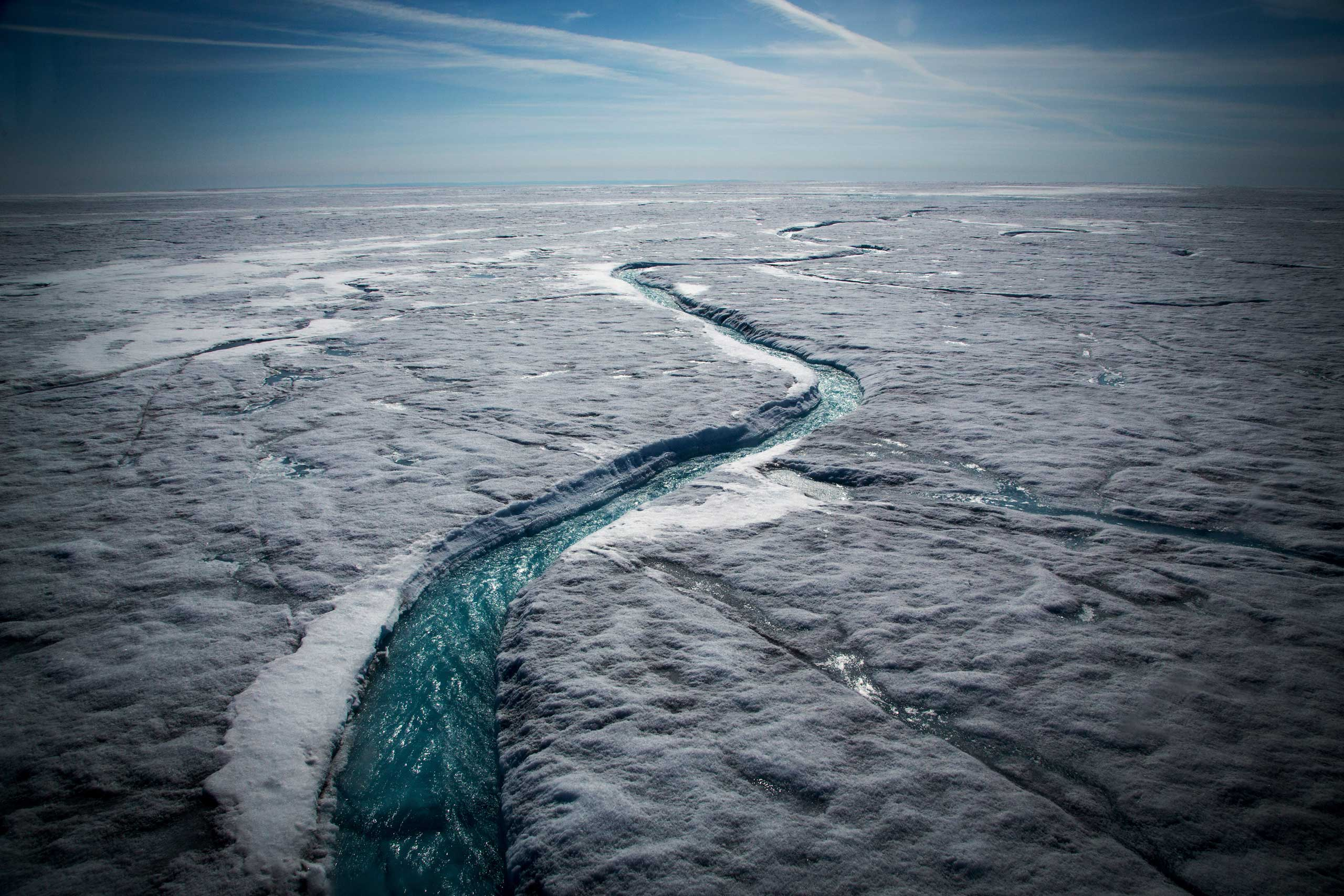 The New York Times:  Greenland Is Melting AwayMeltwater flows along a supraglacial river on the Greenland ice sheet, July 19, 2015.