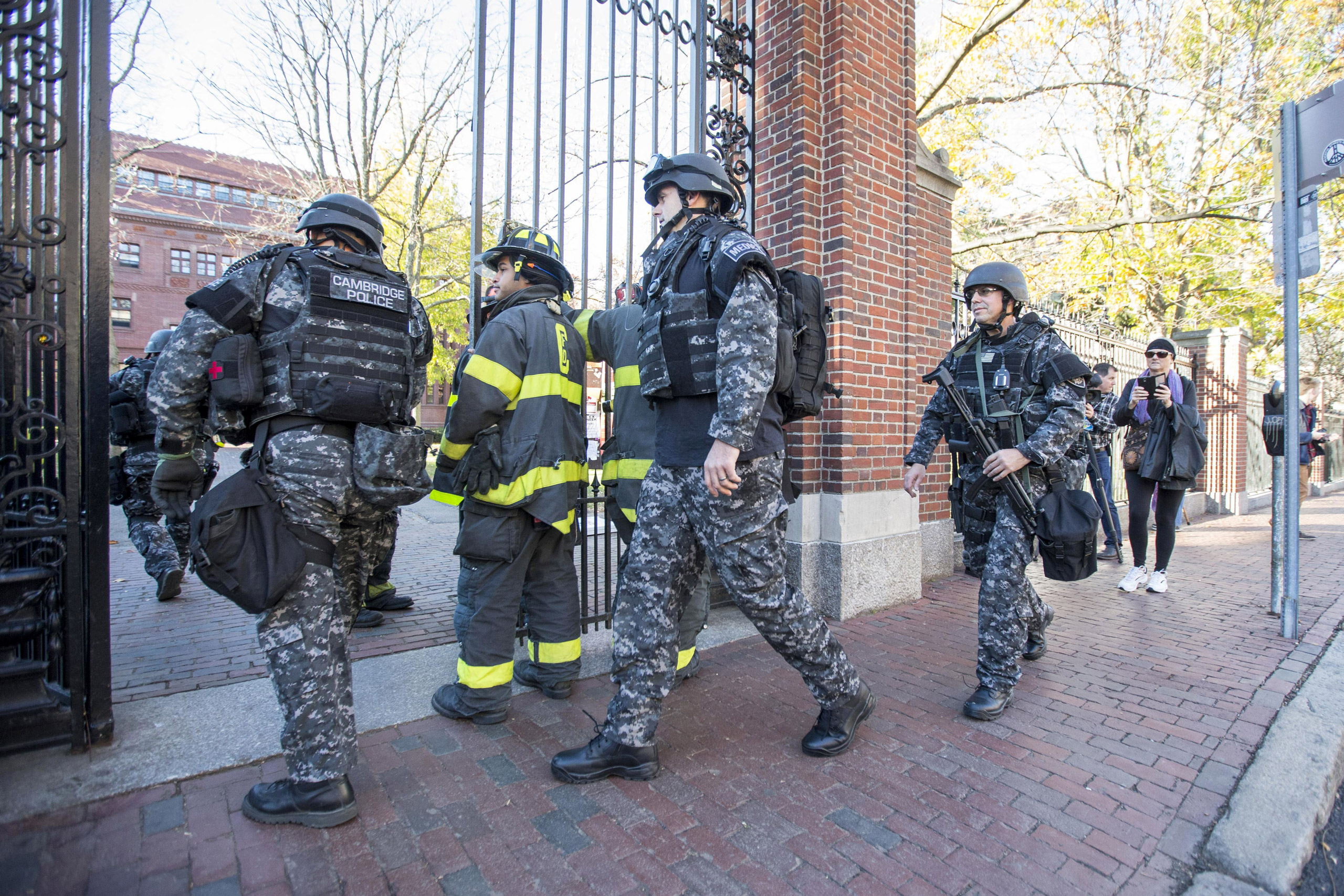 Cambridge Police SWAT team members arrive at Harvard Yard following a bomb threat that was made on campus in Cambridge, Mass., on Nov. 16, 2015.