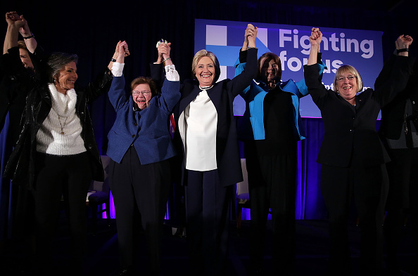 Democratic presidential candidate Hillary Clinton (3rd L) holds up hands with (L-R) Sens. Barbara Boxer (D-CA), Barbara Mikulski (D-MD), and Patty Murray (D-WA) during a 'Women for Hillary' fundraiser November 30, 2015 in Washington, DC.