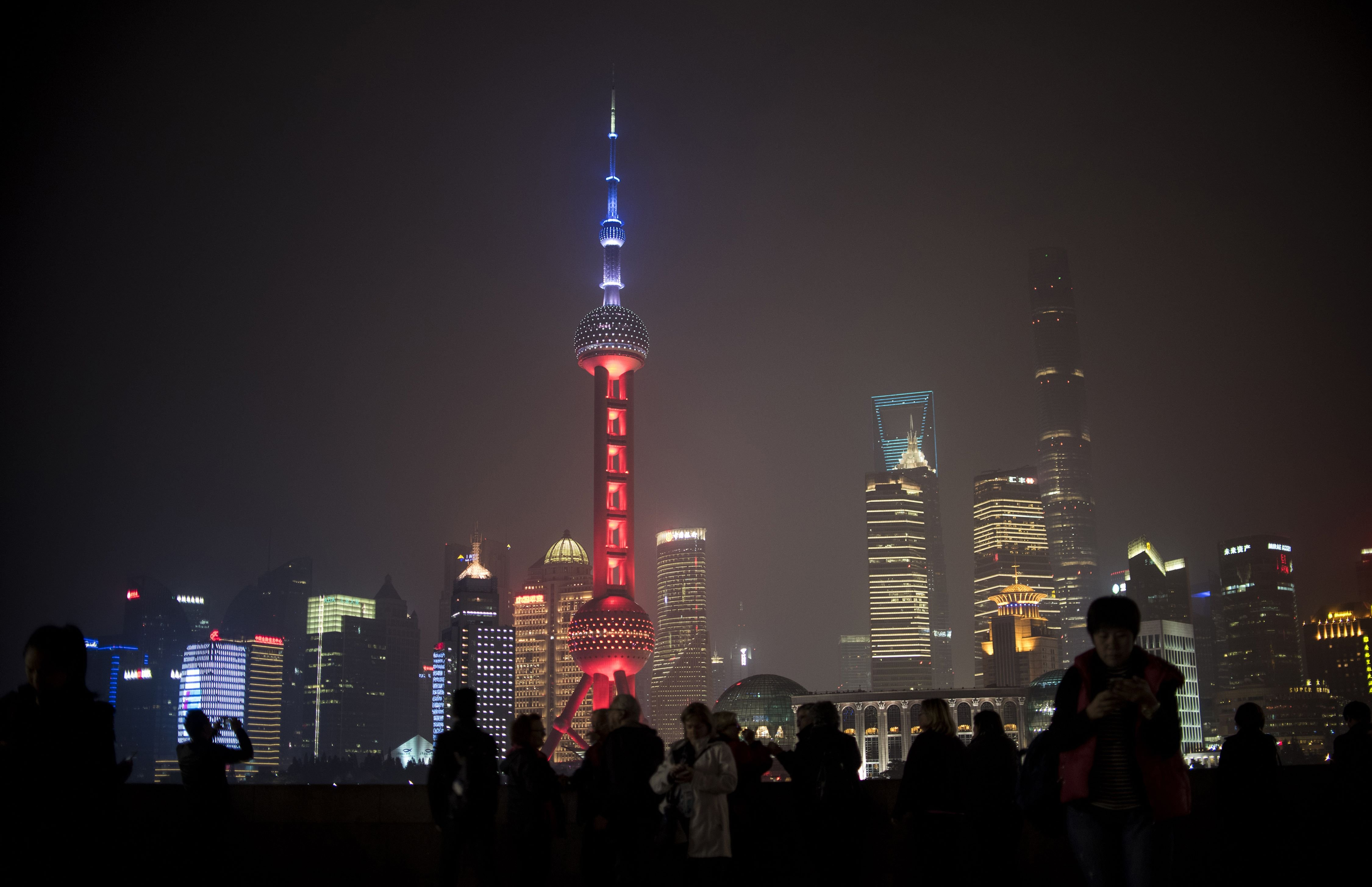 The Oriental Pearl TV Tower is lit as China expressed their solidarity with France, in Shanghai on Nov. 14, 2015.