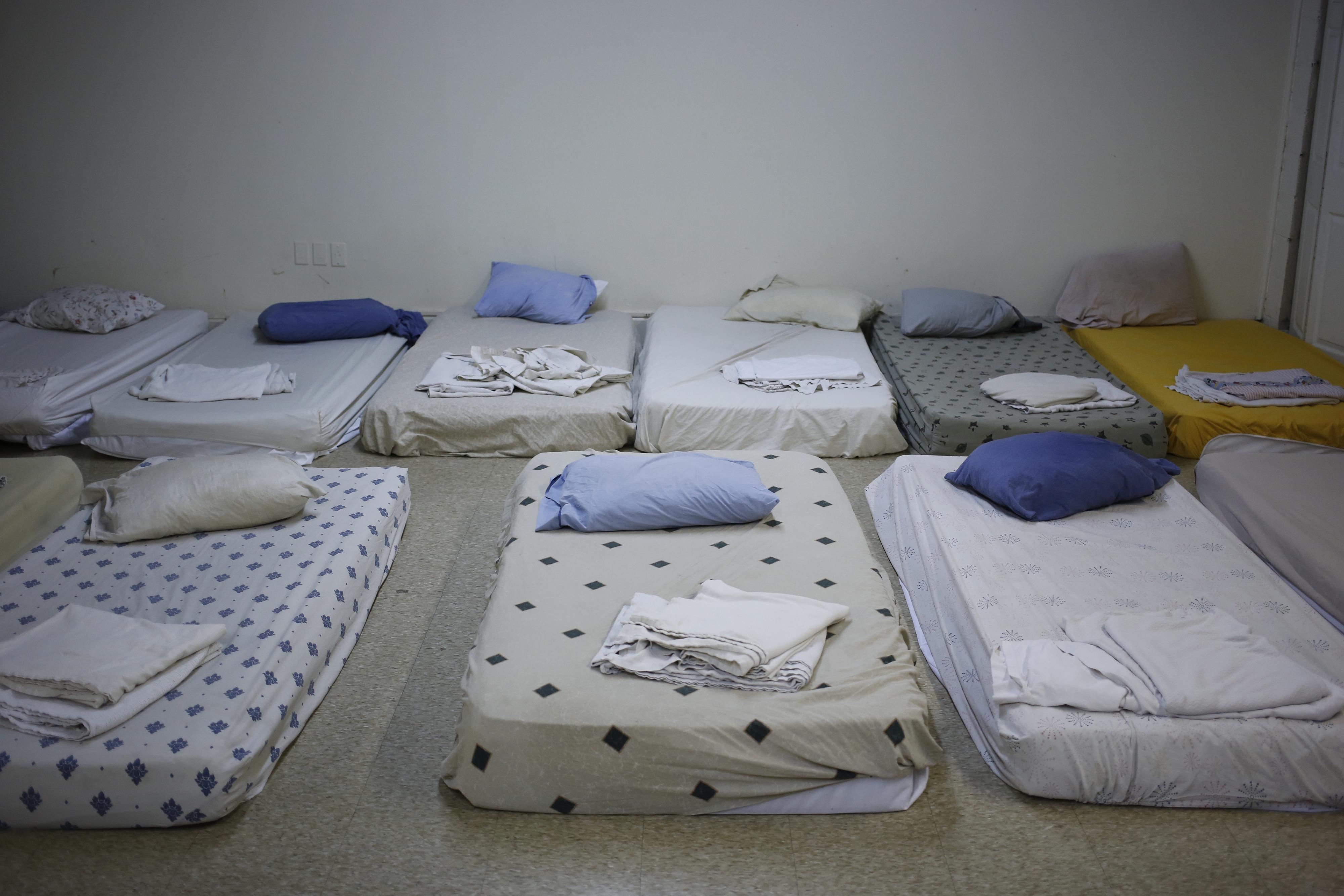 Beds for the homeless are prepared inside the Community Inn homeless shelter in Lexington, KY on Nov. 19, 2013.