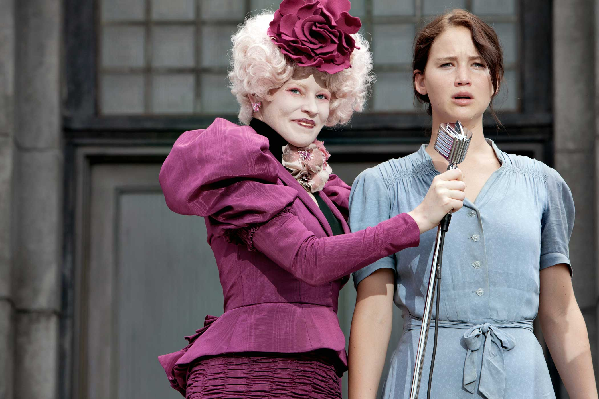 Elizabeth Banks as Effie Trinket and Jennifer Lawrence as Katniss Everdeen in The Hunger Games, 2012.