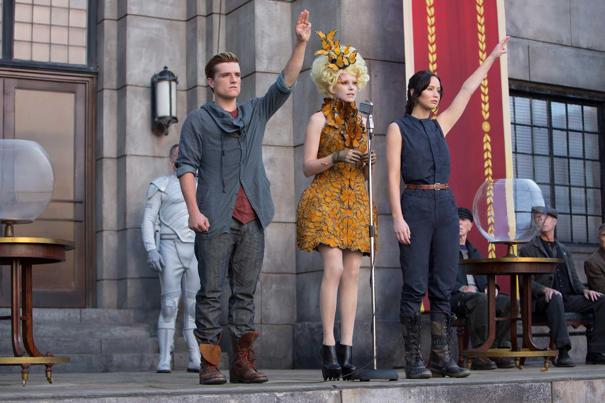 From left: Josh Hutcherson as Peeta Mellark, Elizabeth Banks as Effie Trinket, and Jennifer Lawrence as Katniss Everdeen in The Hunger Games: Catching Fire, 2013.