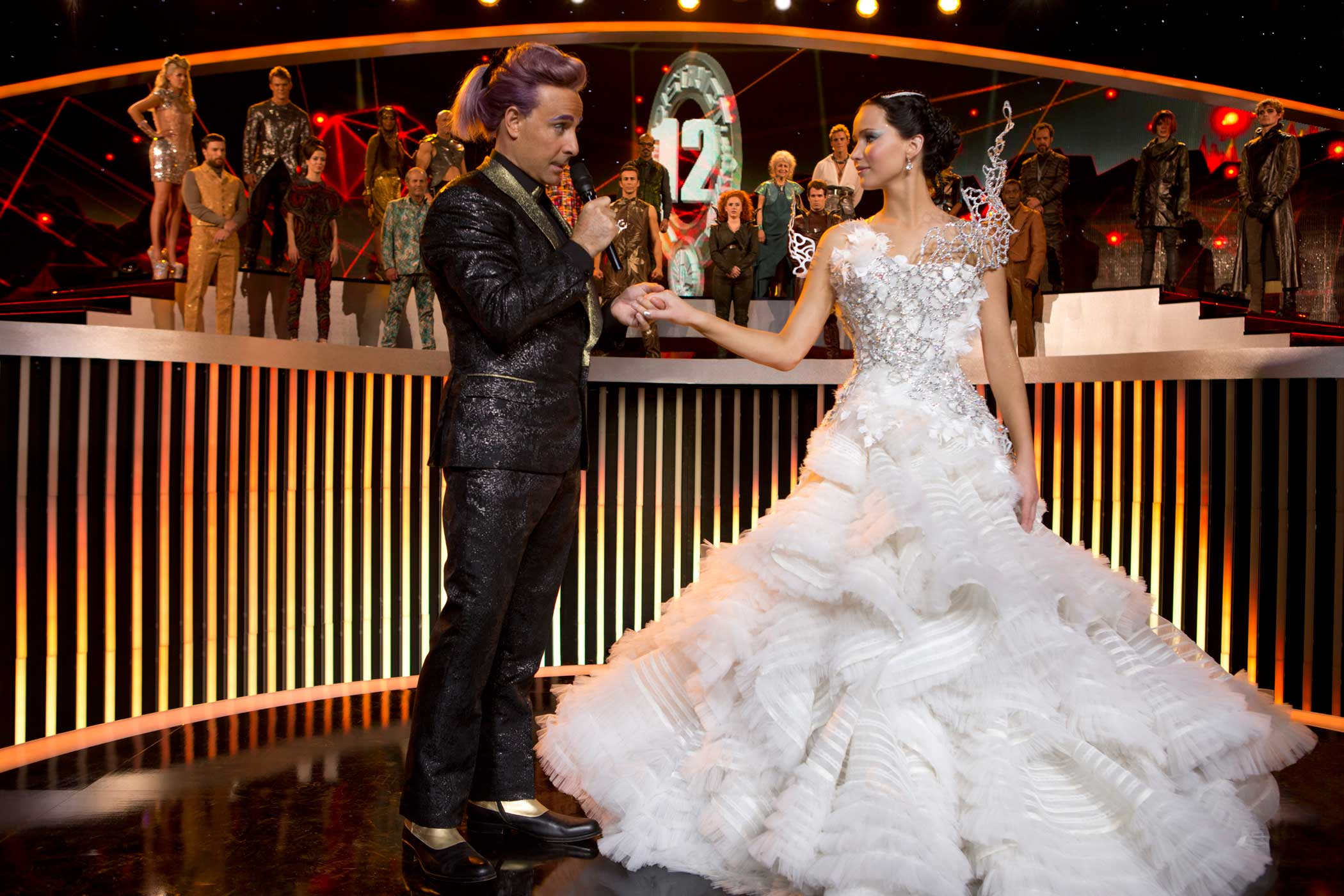 Stanley Tucci as Caesar Flickerman and Jennifer Lawrence as Katniss Everdeen in The Hunger Games: Catching Fire                               , 2013.