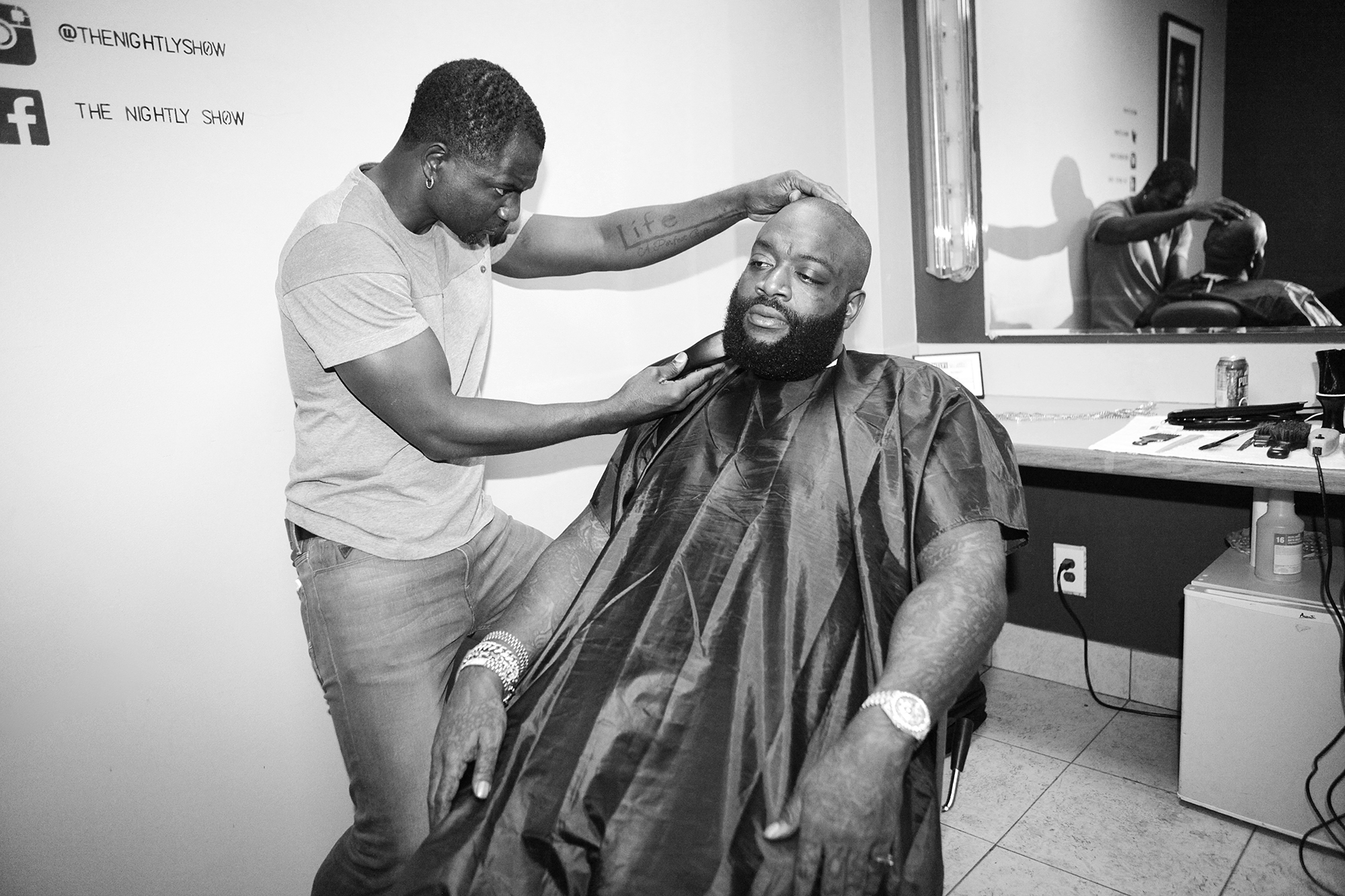 From left: Barber Peter Graham and Rick Ross backstage at The Nightly Show with Larry Wilmore on Nov. 12, 2015 in New York City.