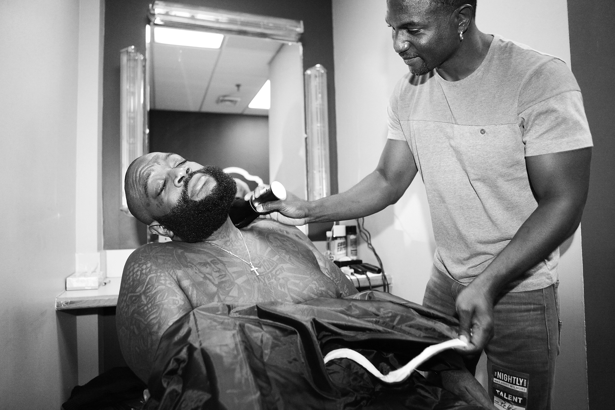 From left: Rick Ross and barber Peter Graham backstage at The Nightly Show with Larry Wilmore on Nov. 12, 2015 in New York City.