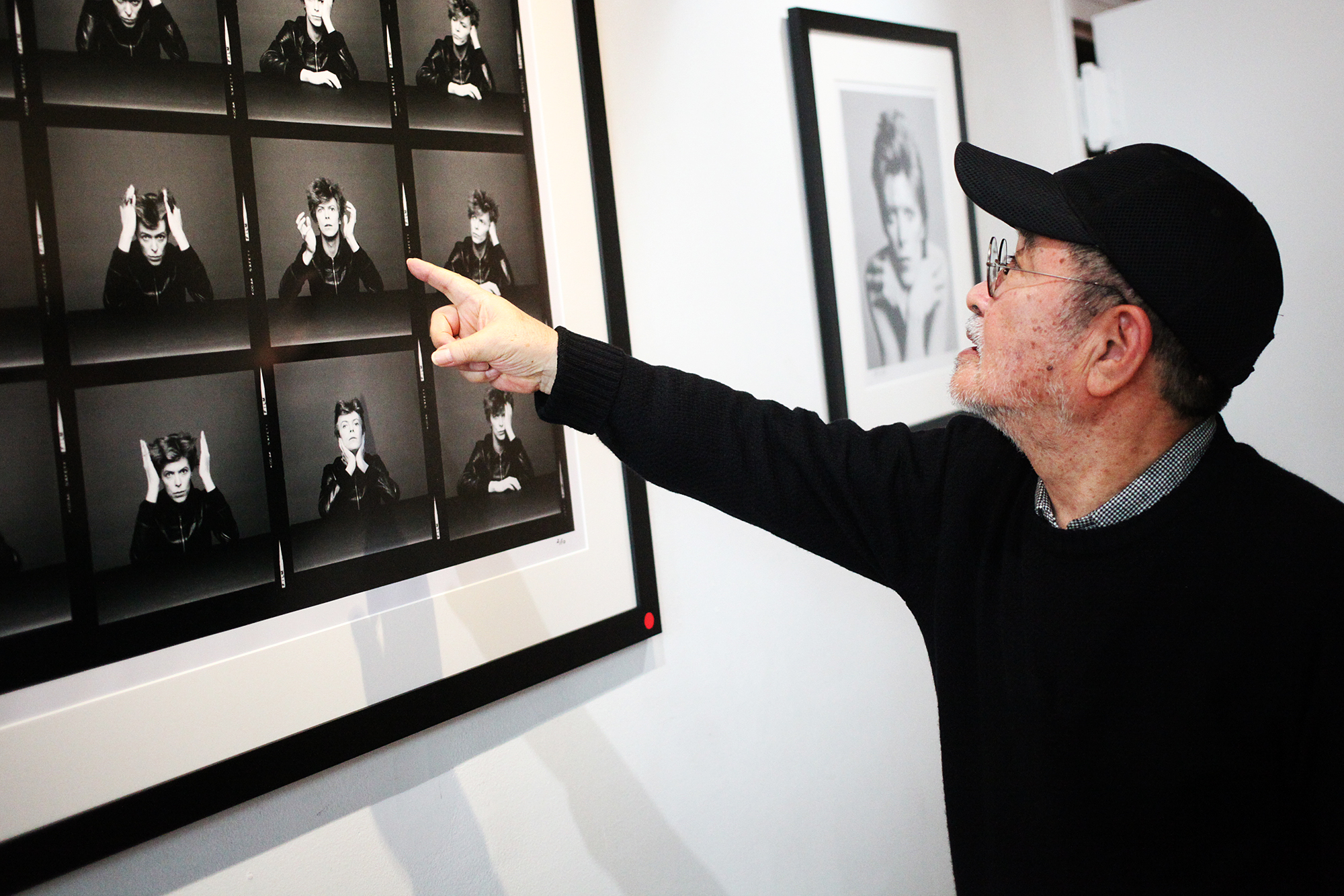 Masayoshi Sukita points out his favorite image from his shoot with David Bowie for the Heroes album cover at the Morrison Hotel Gallery in New York City on Nov. 13, 2015. Kenneth Bachor for TIME
