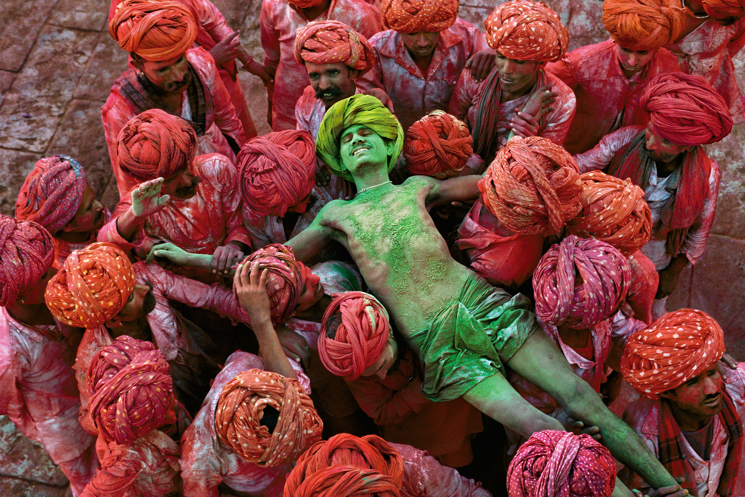 Crowd carries a man during the Holi Festival. Rajasthan, 1996