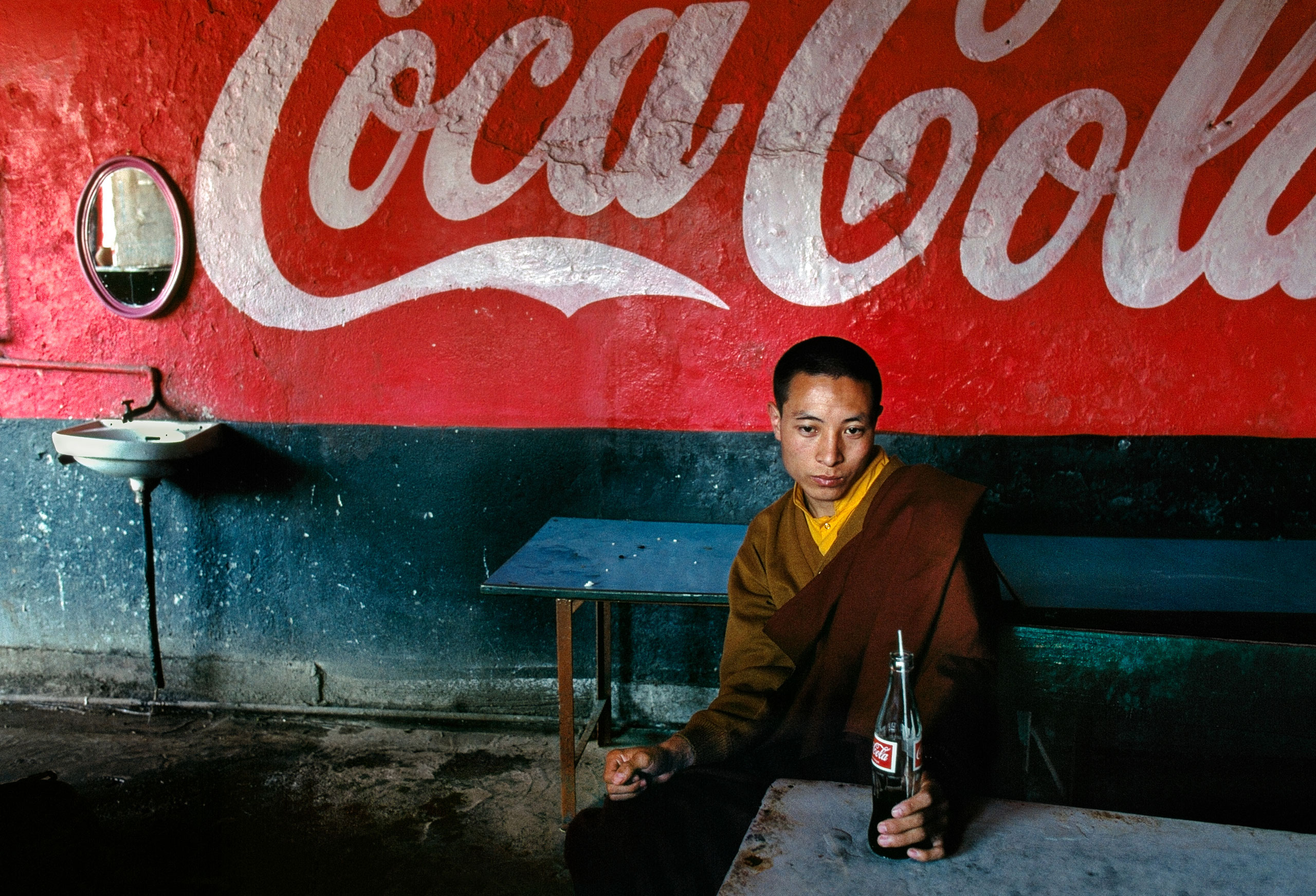 Monk in a food stall. Bodh Gaya, Bihar, 2000
