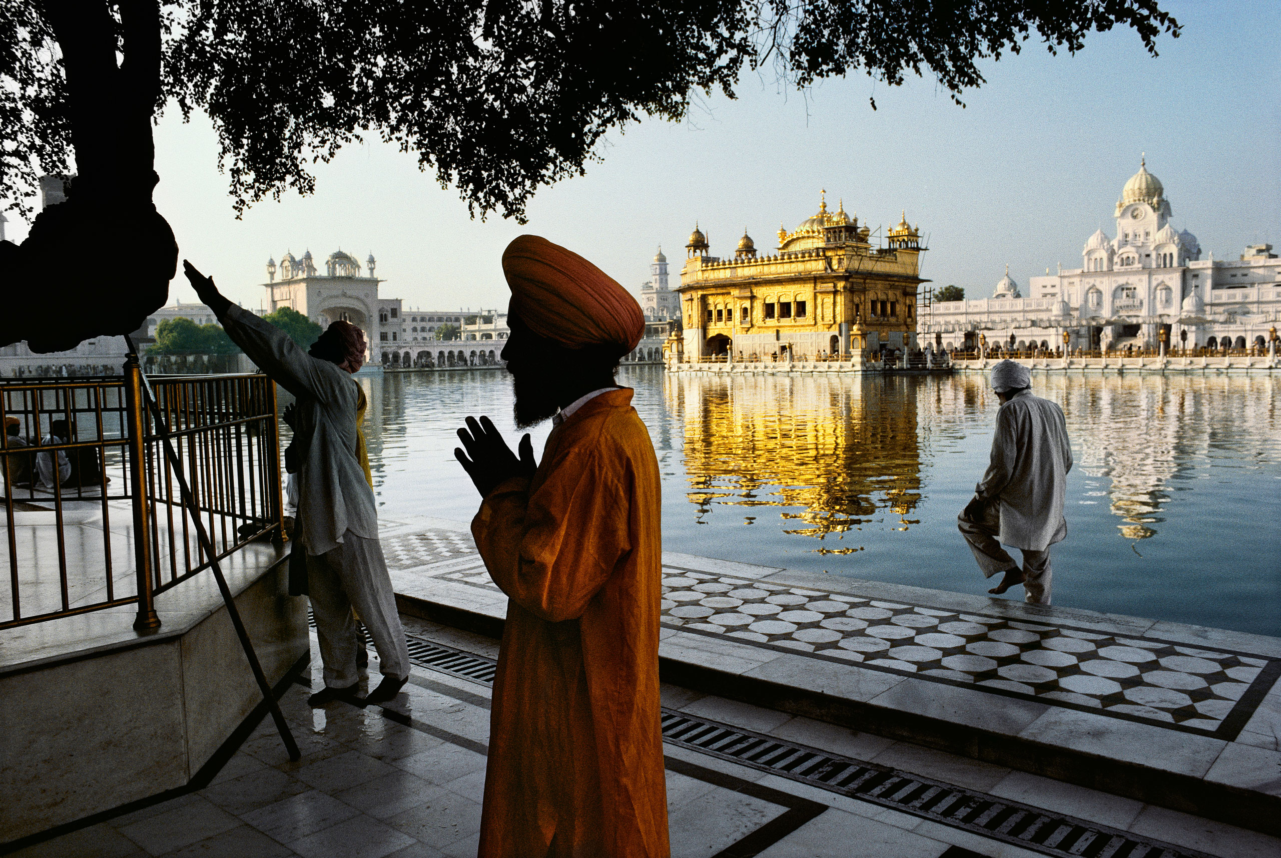 Sikh devotee prays at the Golden Temple Amritsar, Punjab, 1996