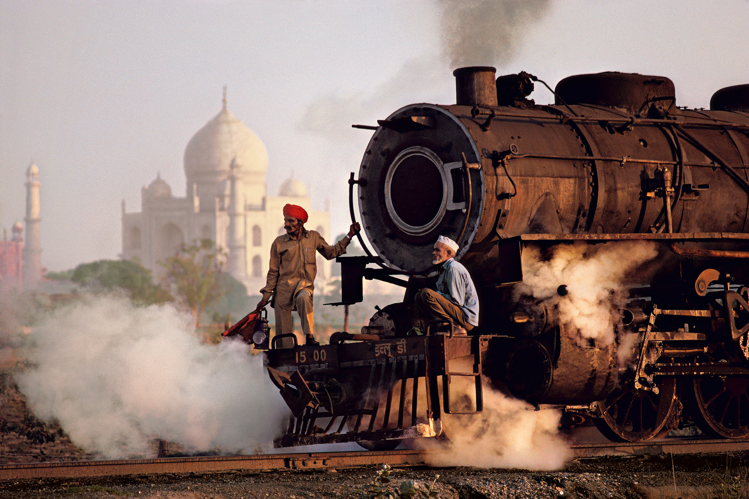 Steam engine passes in front of the Taj Mahal. Agra, Uttar Pradesh, 1983