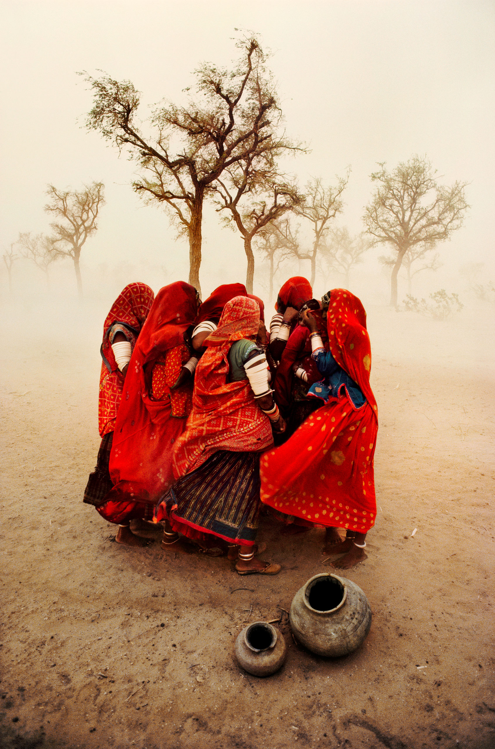 Women shielding themselves from a dust storm Rajasthan, 1983
