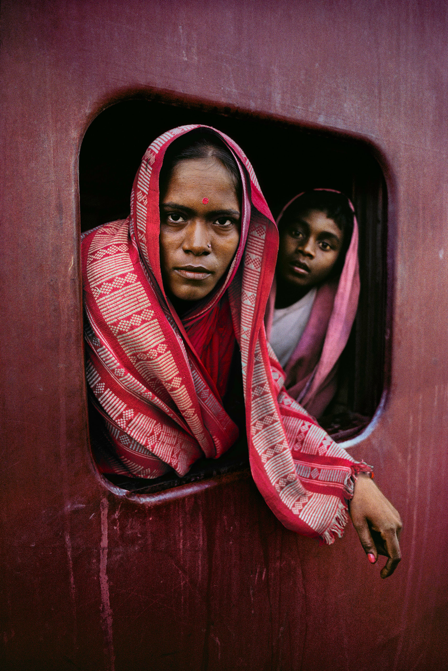 Woman and child on the Howrah Mail train en route to Kolkata.                               West Bengal, 1982.