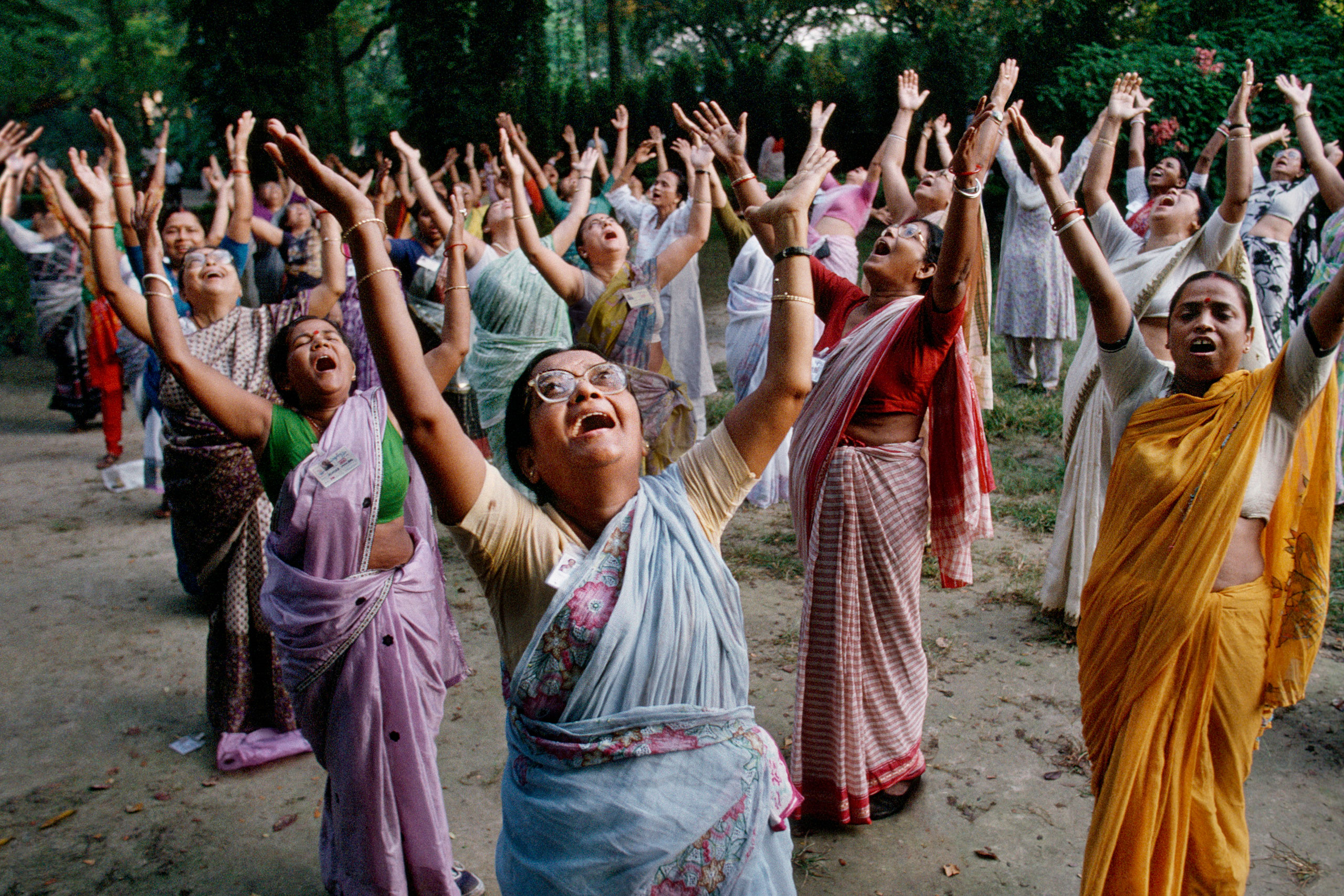 Women participate in a laughter club at Mumbai's Hanging Gardens.                               Mumbai, 1996