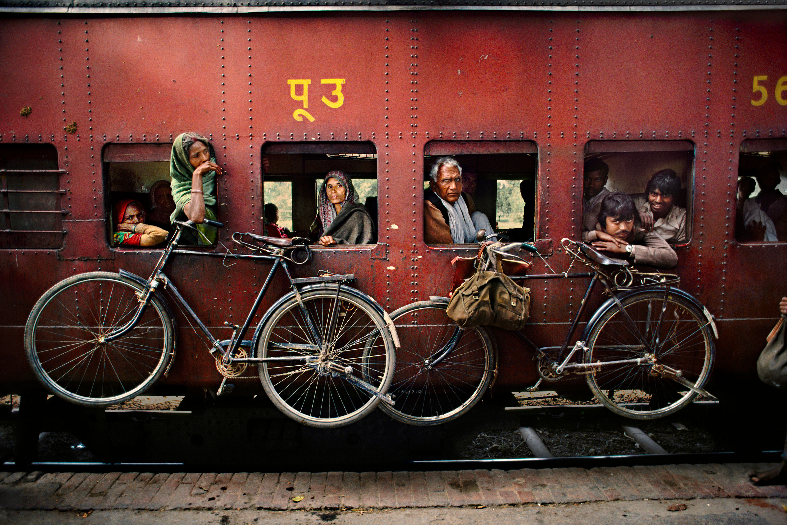 Bicycles hanging on the side of a train. West Bengal, India, 1983