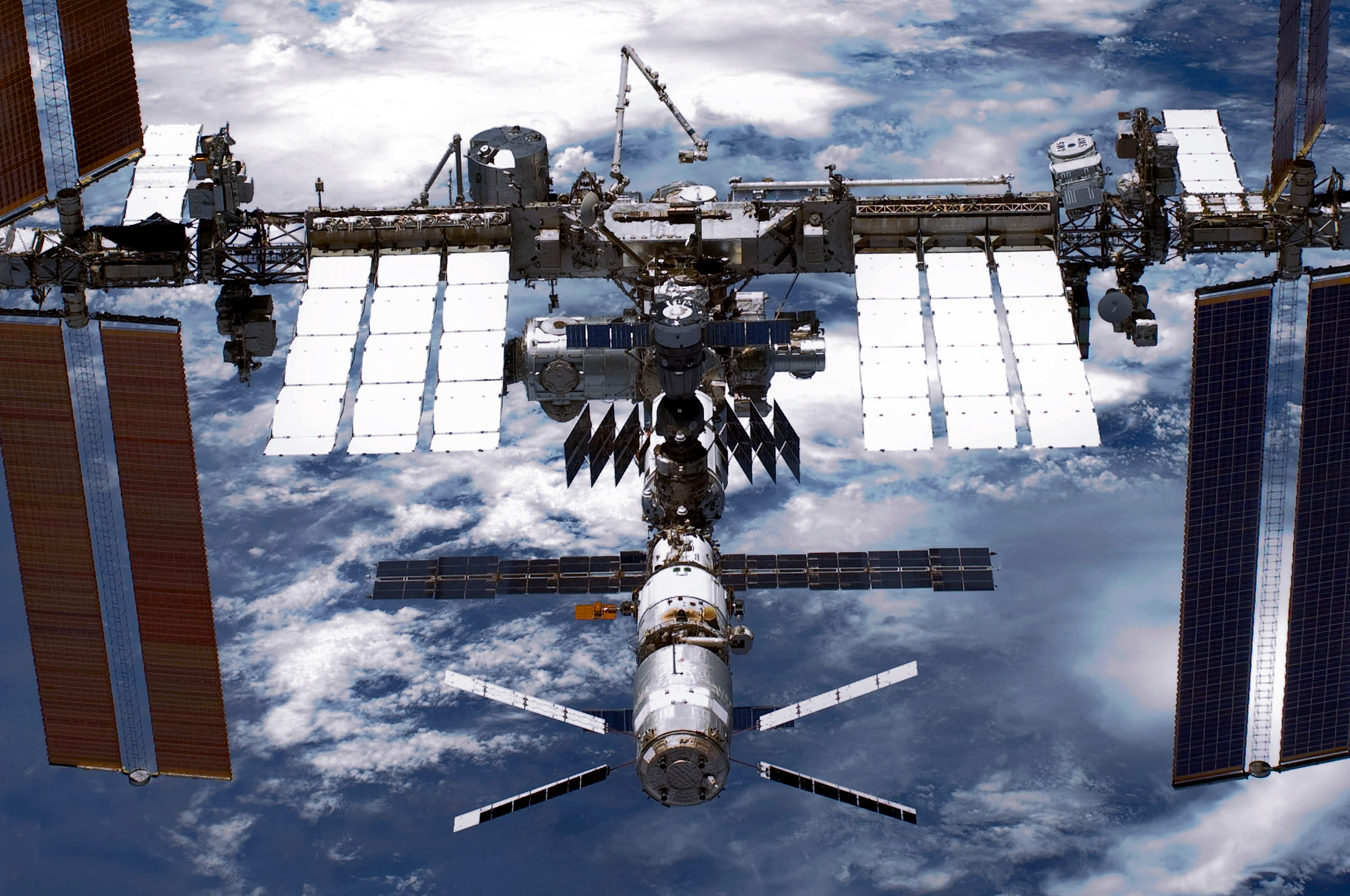 In this handout provided by National Aeronautics and Space Administration (NASA), back dropped by planet Earth the International Space Station (ISS) is seen from NASA space shuttle Endeavour after the station and shuttle began their post-undocking relative separation May 29, 2011 in space.