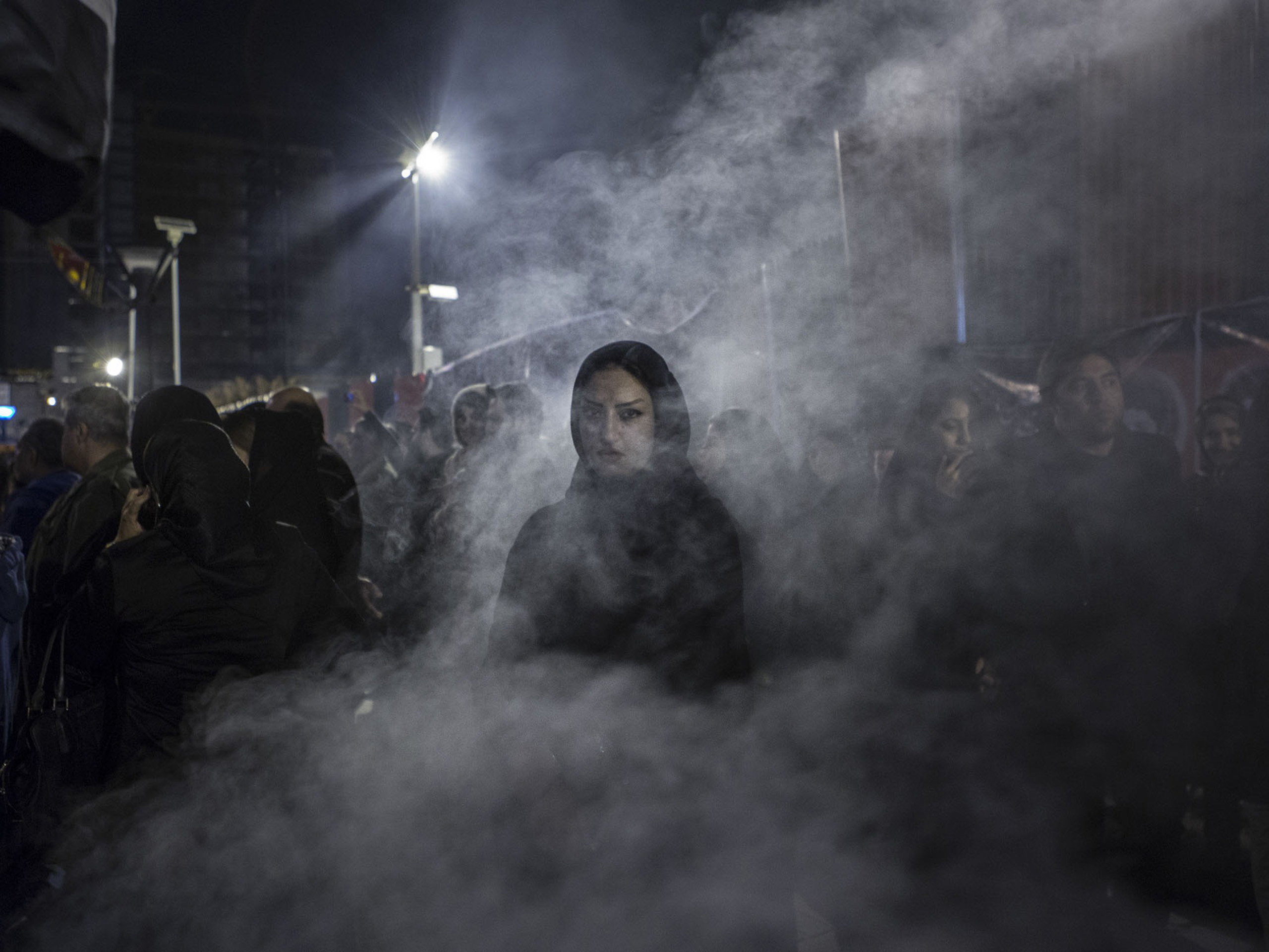 A woman in Tehran wreathed by the smoke of an herb burned during festivities marking the death of Hussein, the third Shi'ite imam.