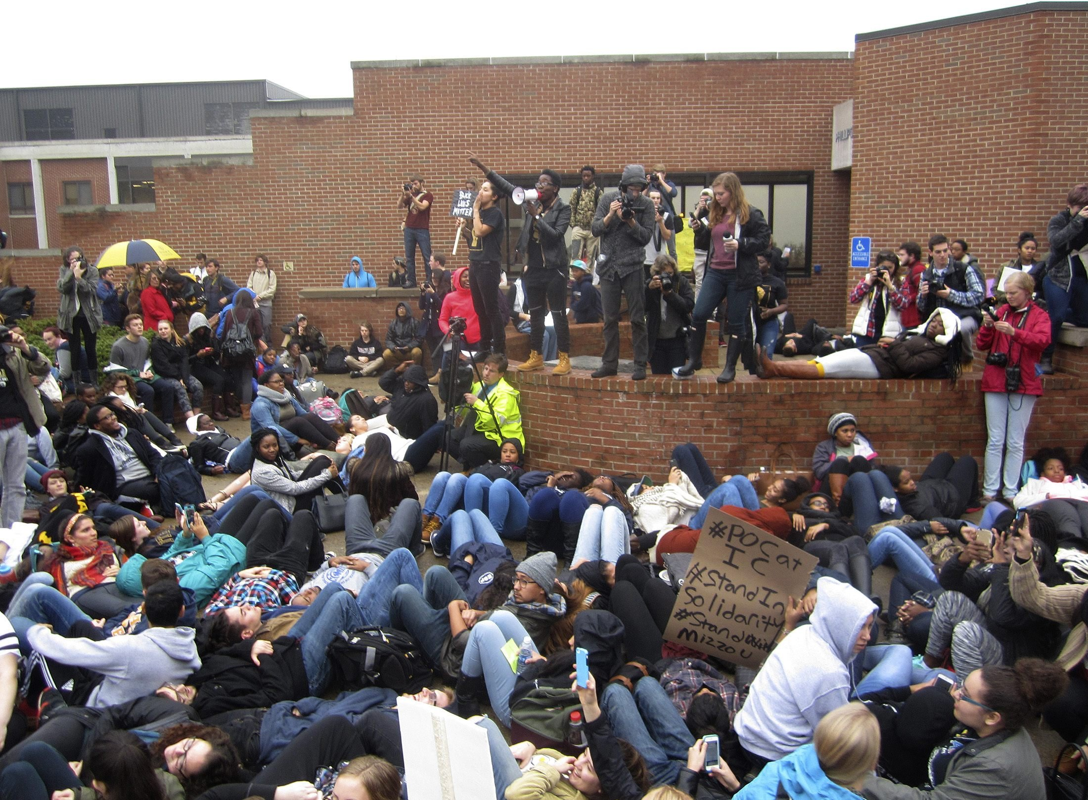 Protestorsr encourage students to lay down as part of a 'die-in' this afternoon at Ithaca College in Ithaca, New York on Nov. 11, 2015.