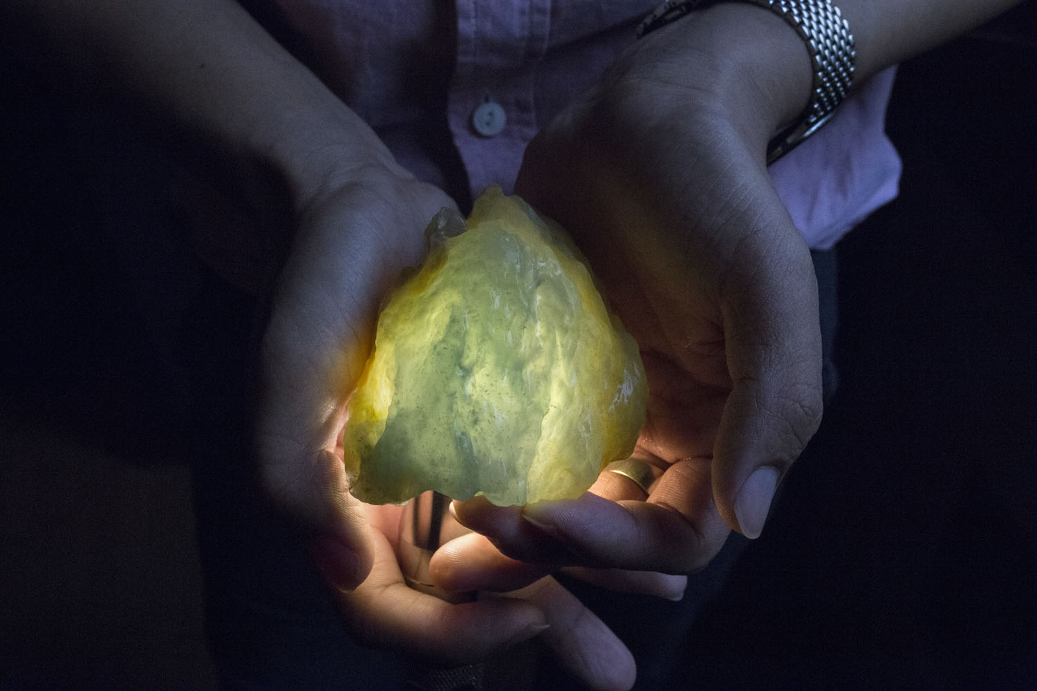 A trader shows a jade stone which he estimates to be worth at least forty or fifty thousands U.S. dollars in price in the black market, at a hotel room in Yin Jiang, China, June 17, 2015. According to the Myanmar jade traders of the black market, almost all the raw jade stones which are being traded in Yin Jiang are smuggled directly from the black market in Burma's Kachin state where the billion-dollar industry is based