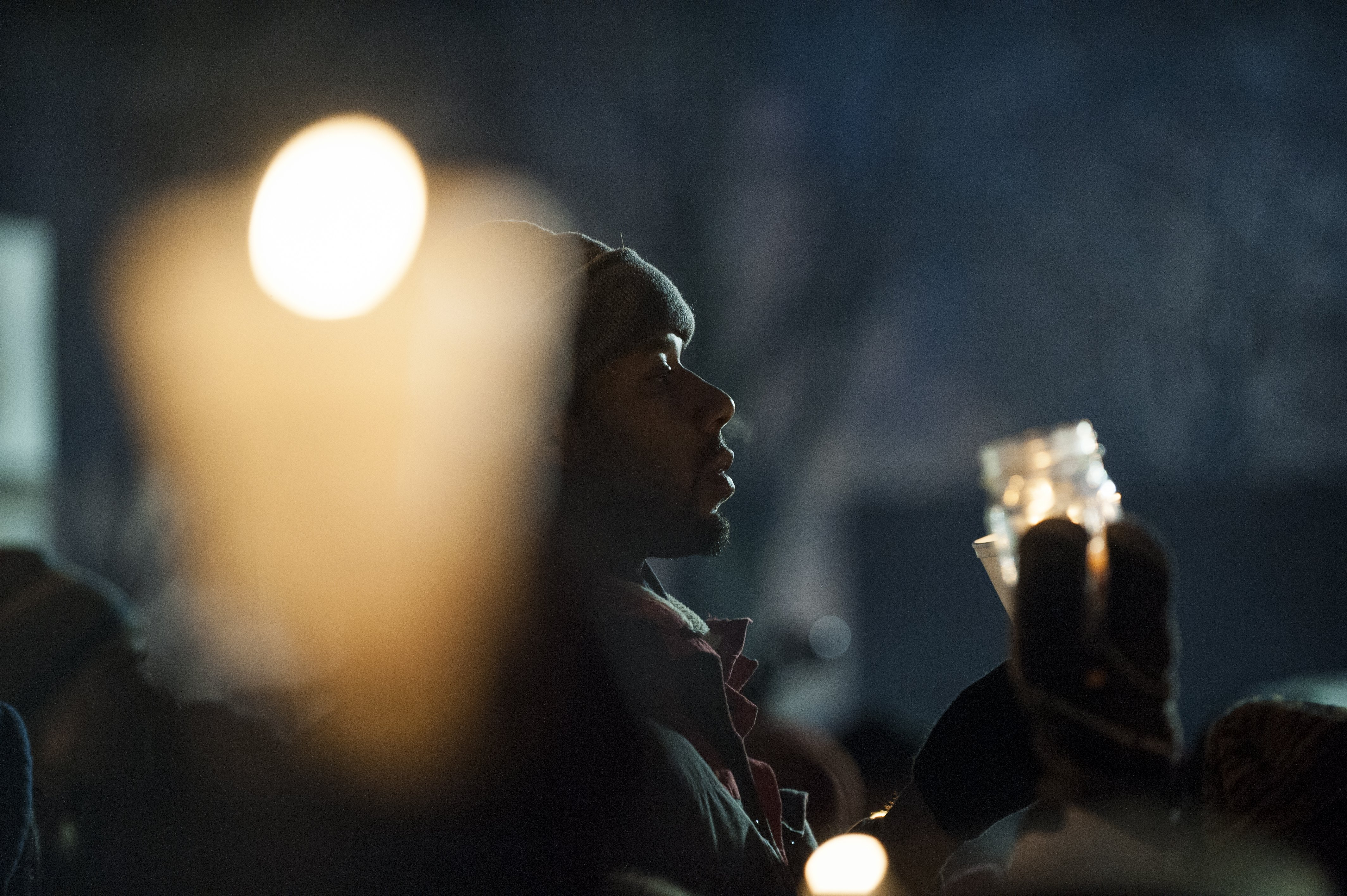 Protestors, activists, and community members listen to speeches at a candlelight vigil held for Jamar Clark outside the 4th police precinct  in Minneapolis on Nov. 20, 2015.