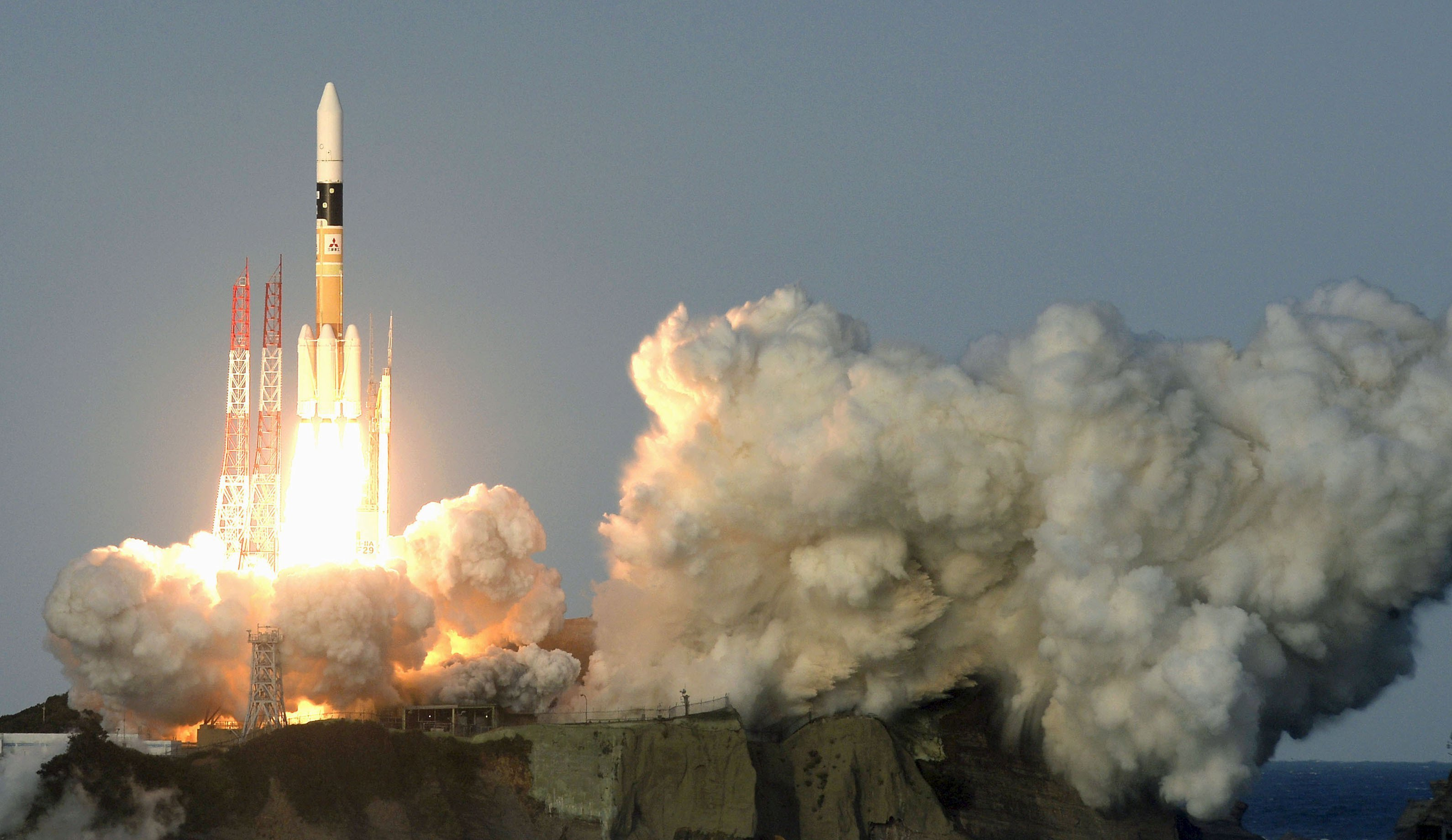 A H-IIA rocket lifts off from the launching pad at Tanegashima Space Center on the Japanese southwestern island of Tanegashima on Nov. 24, 2015.